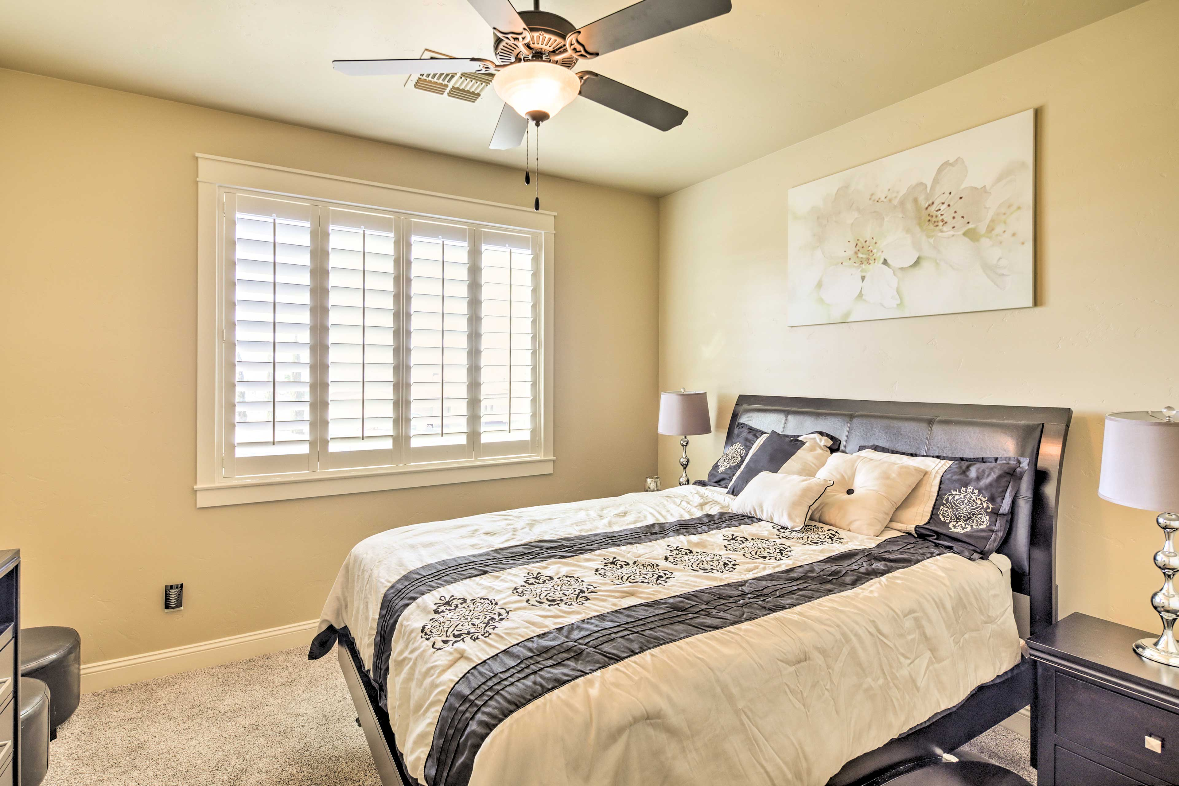 Sleep is sure to come easy on this last bedroom's queen bed.