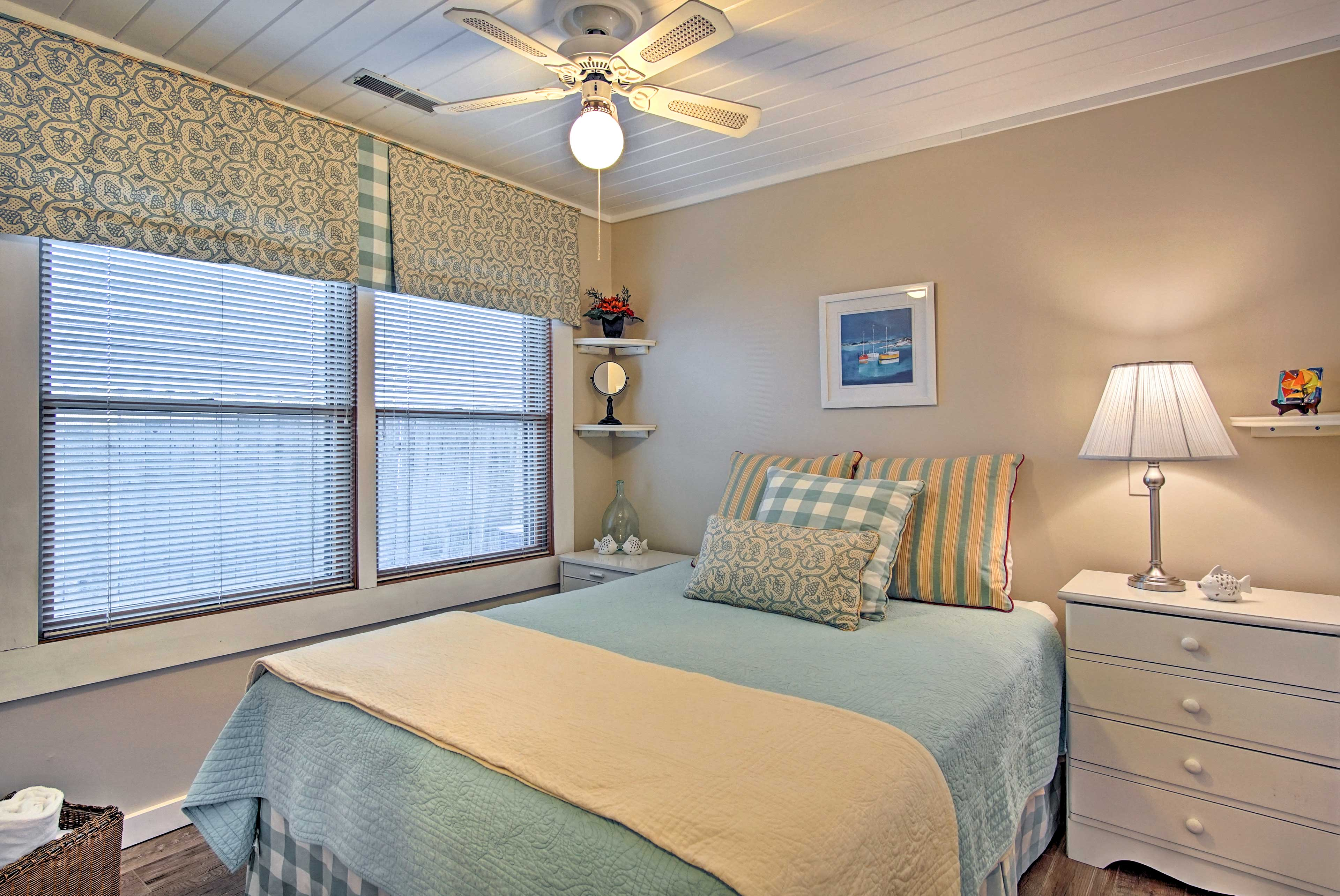 The second bedroom features a soft queen bed.