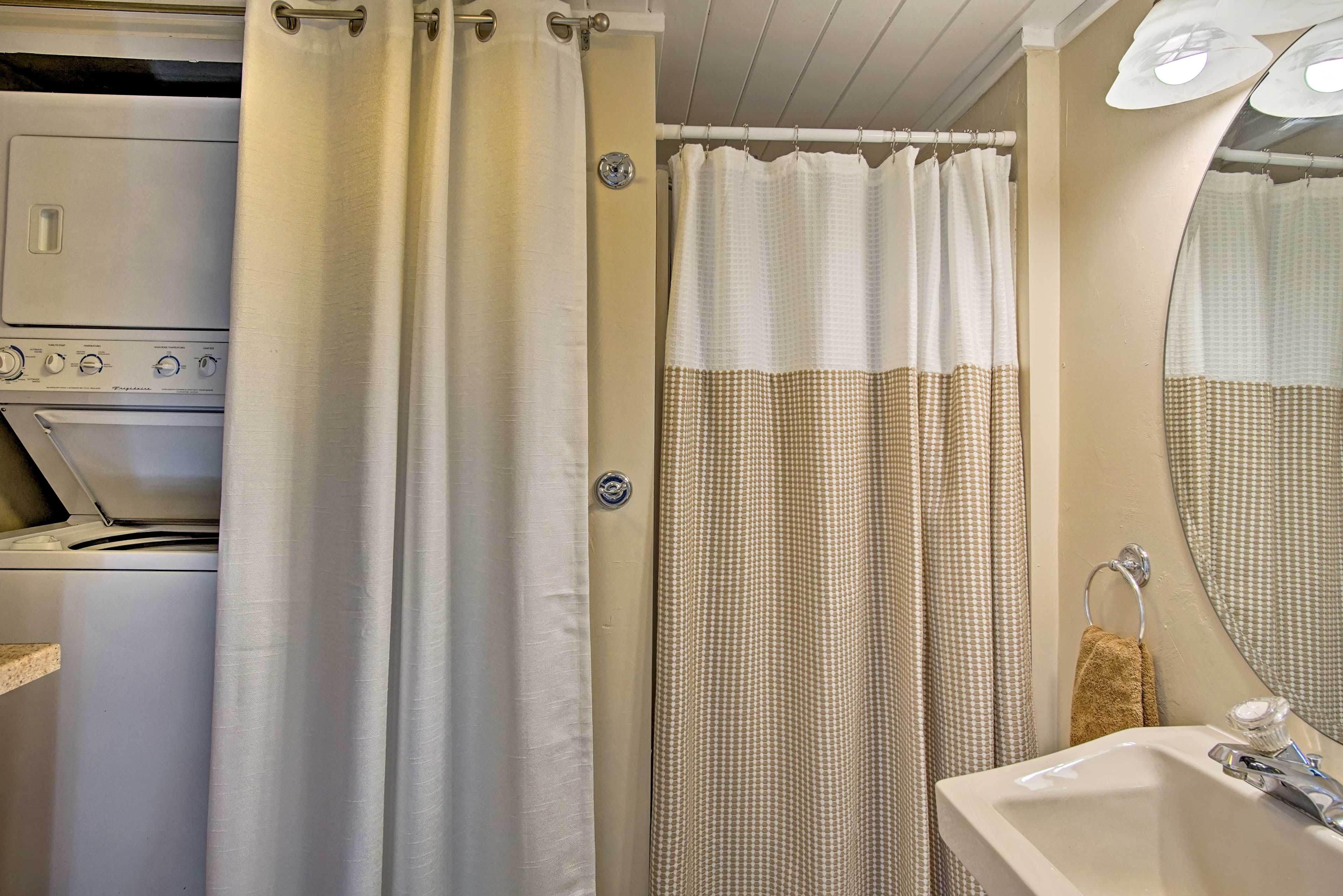 The in-unit laundry machines are located in the bathroom.