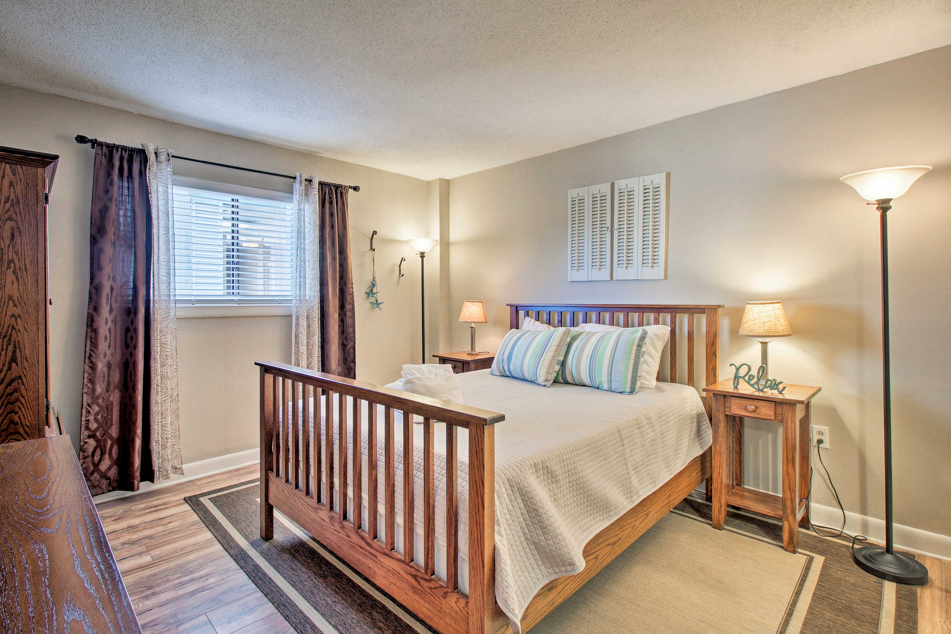 Enjoy a late-night show on the flat-screen TV in the master bedroom.