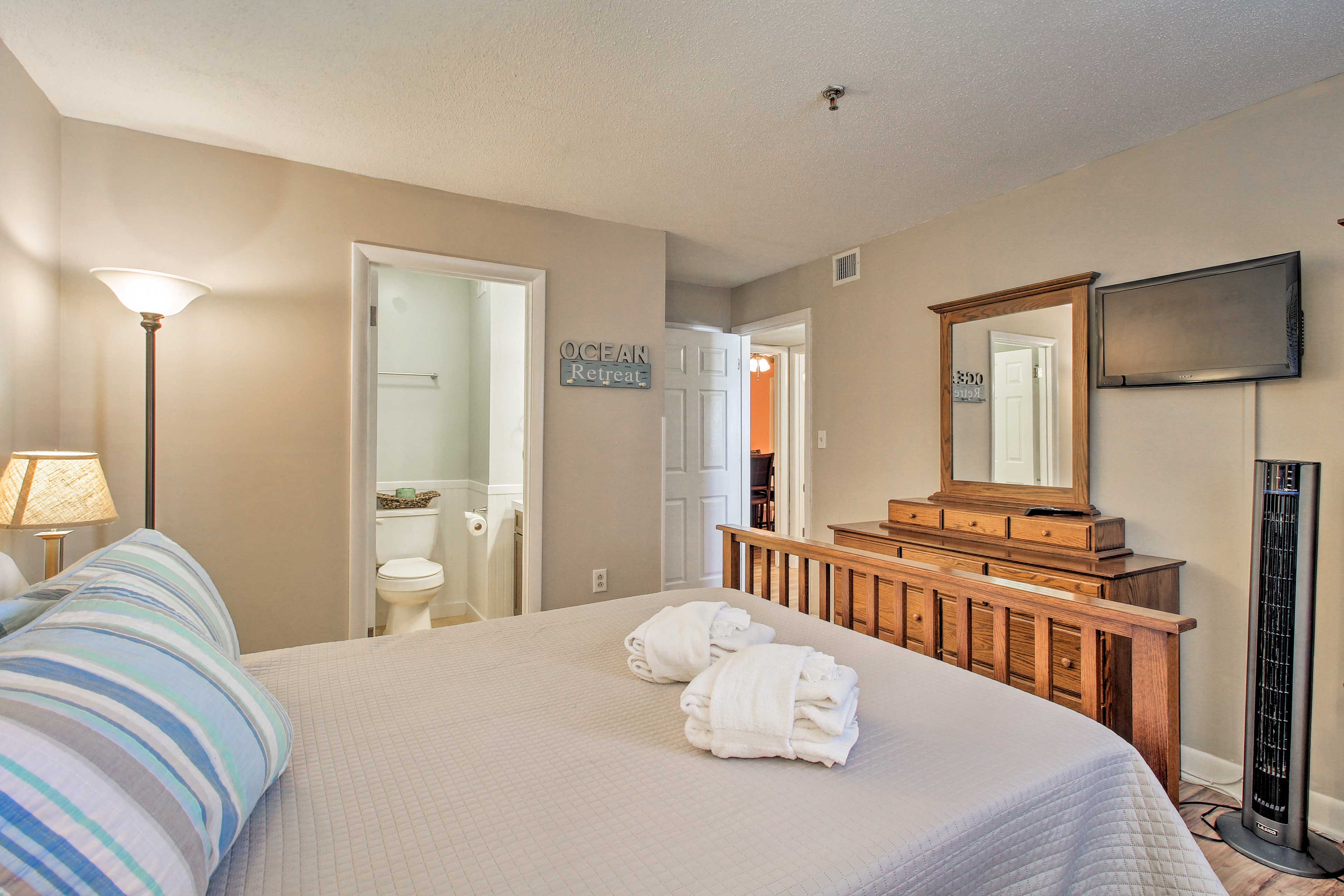 The master bedroom features a cozy queen-sized bed.