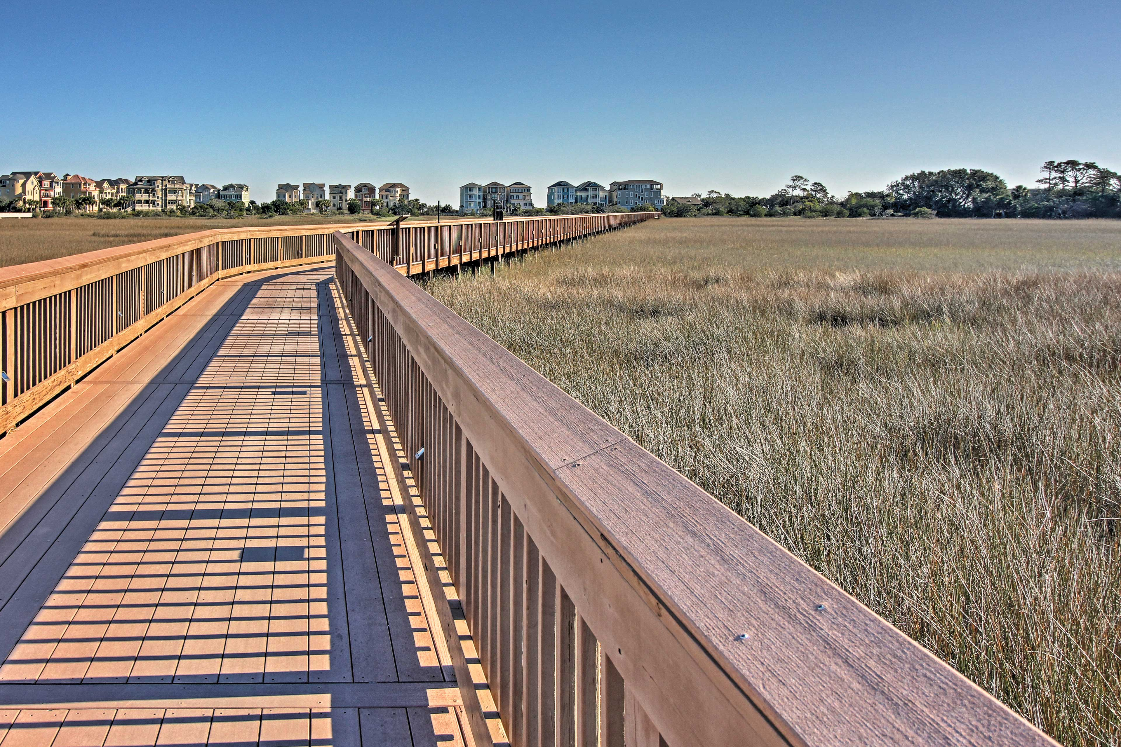 Stroll down the boardwalk or hop on the free golf cart shuttle to the beach!
