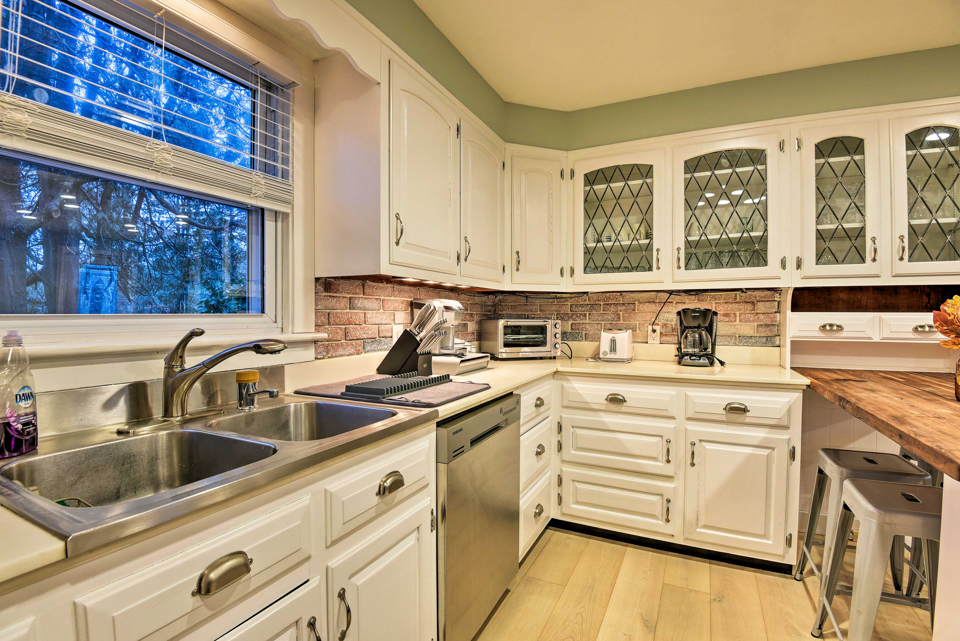 The sleek kitchen is adorned with stainless steel appliances.