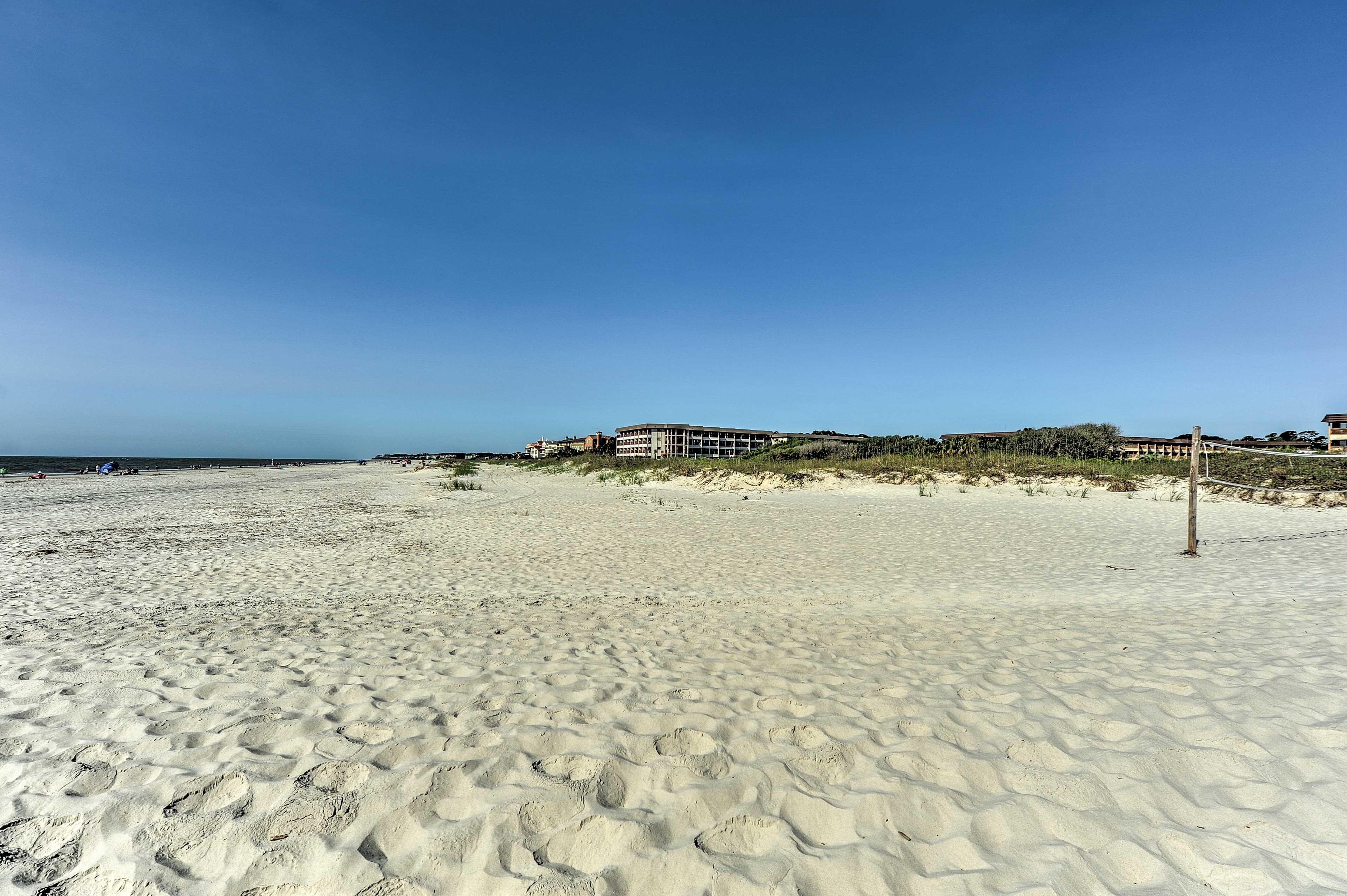The wide sandy beach is just a short walk away.