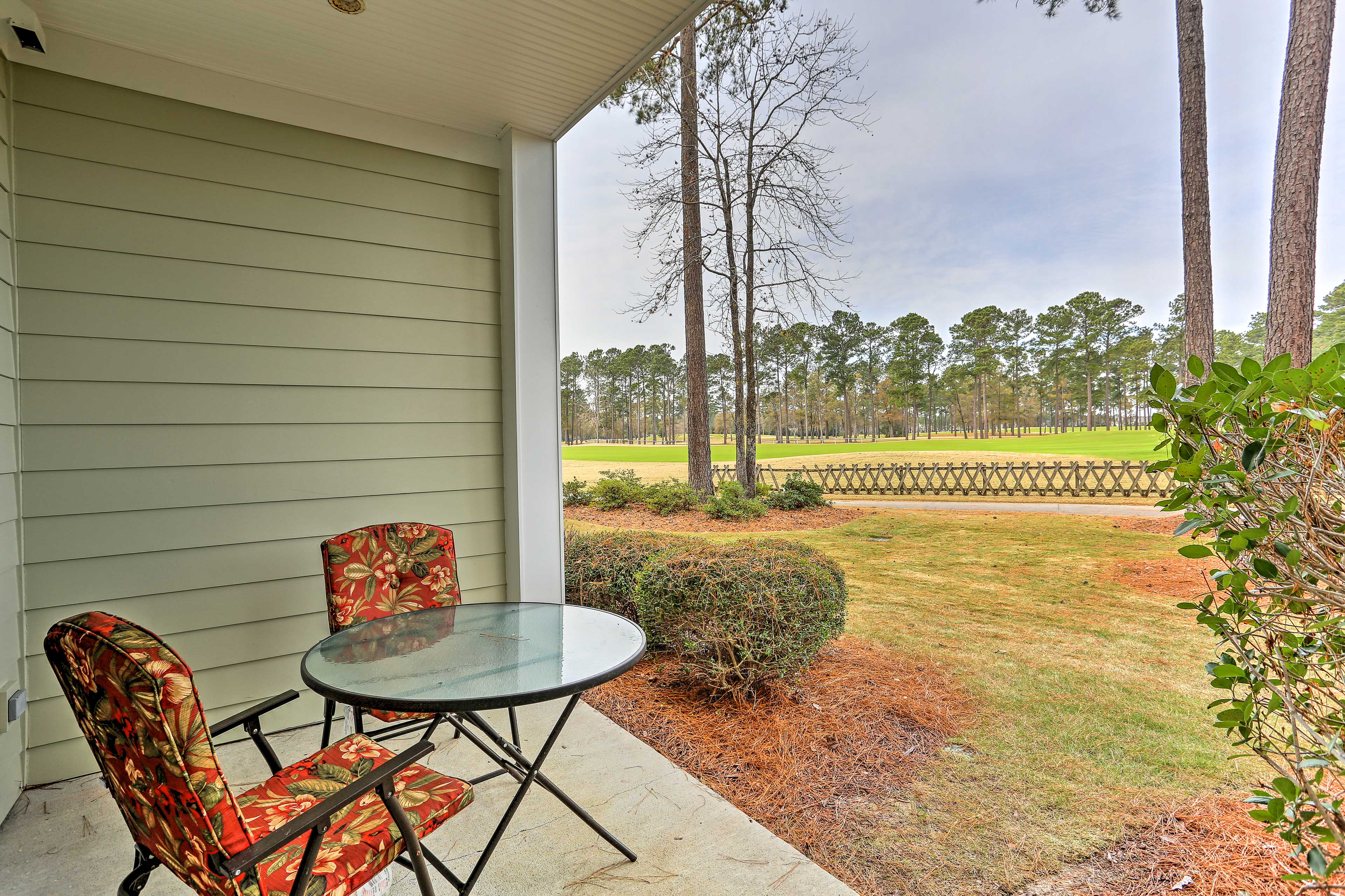 Enjoy the golf course views from this unit's furnished back patio.