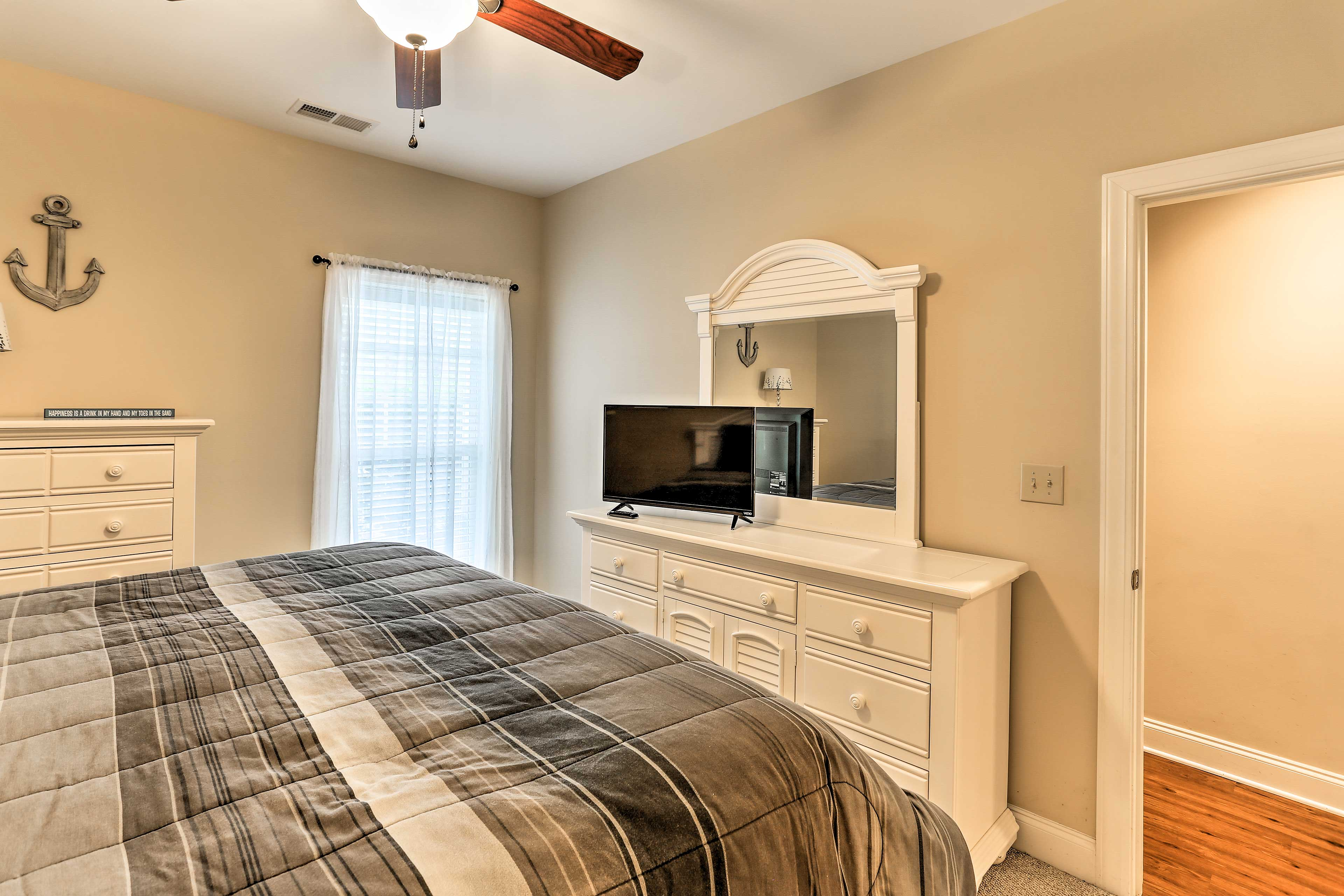This first bedroom offers a king-sized bed and a flat-screen cable TV.