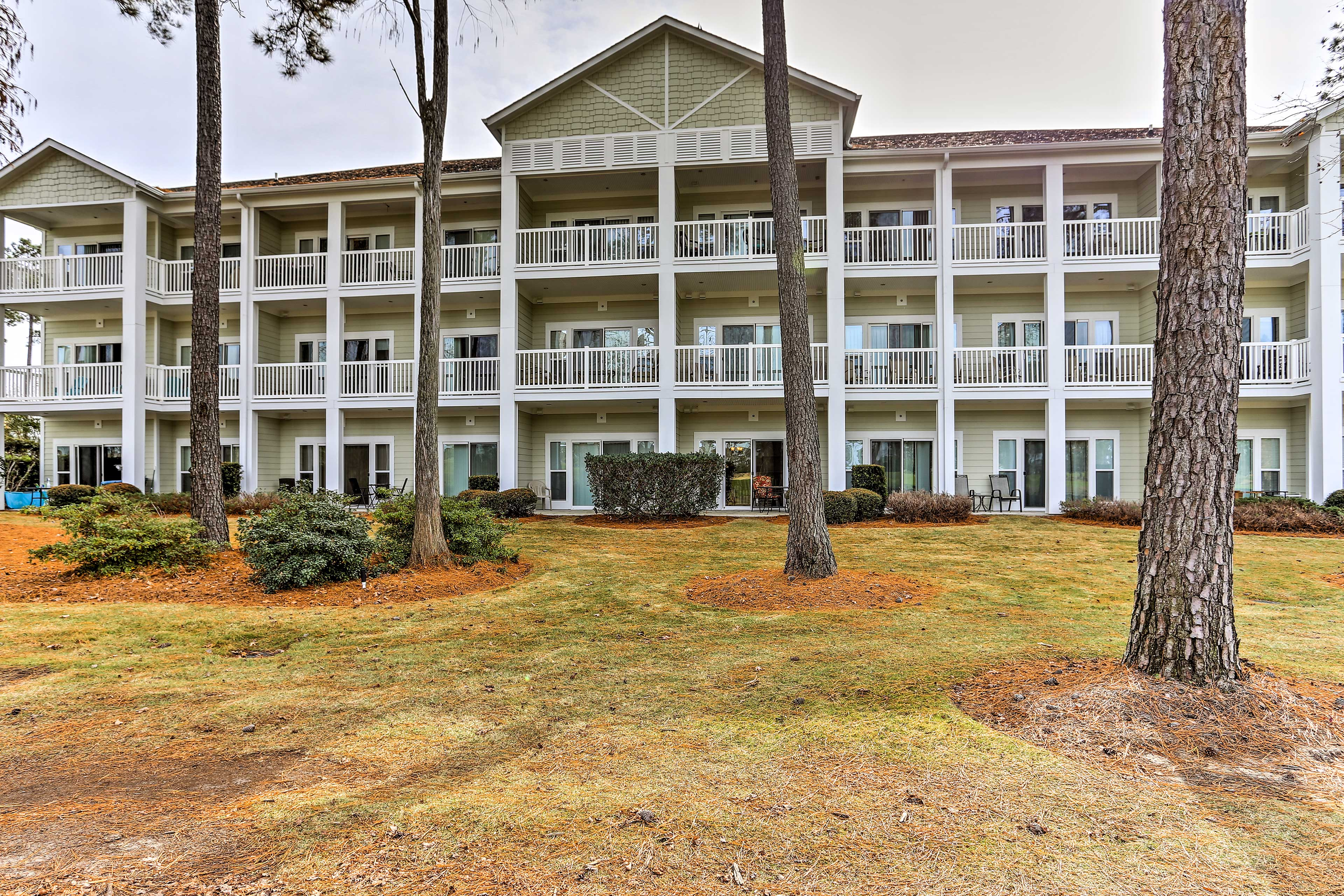 The golf course is just steps away from this condo!