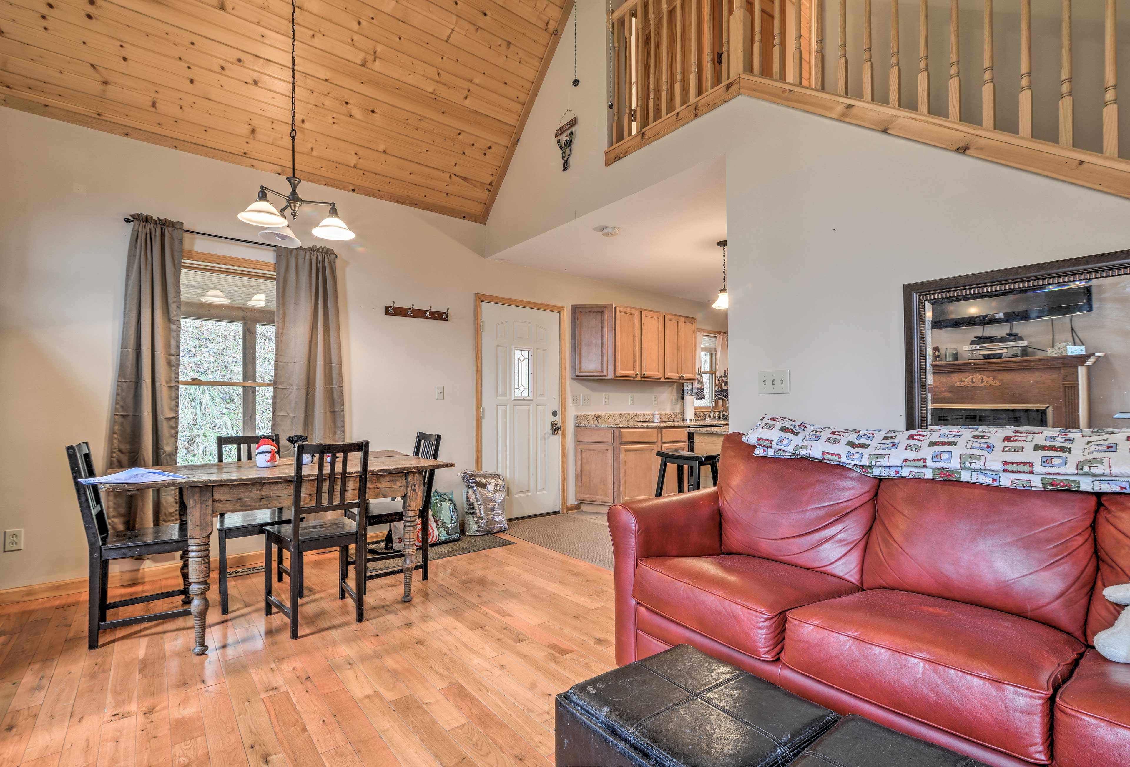 An open floor plan and high ceilings create an open atmosphere inside the cabin.