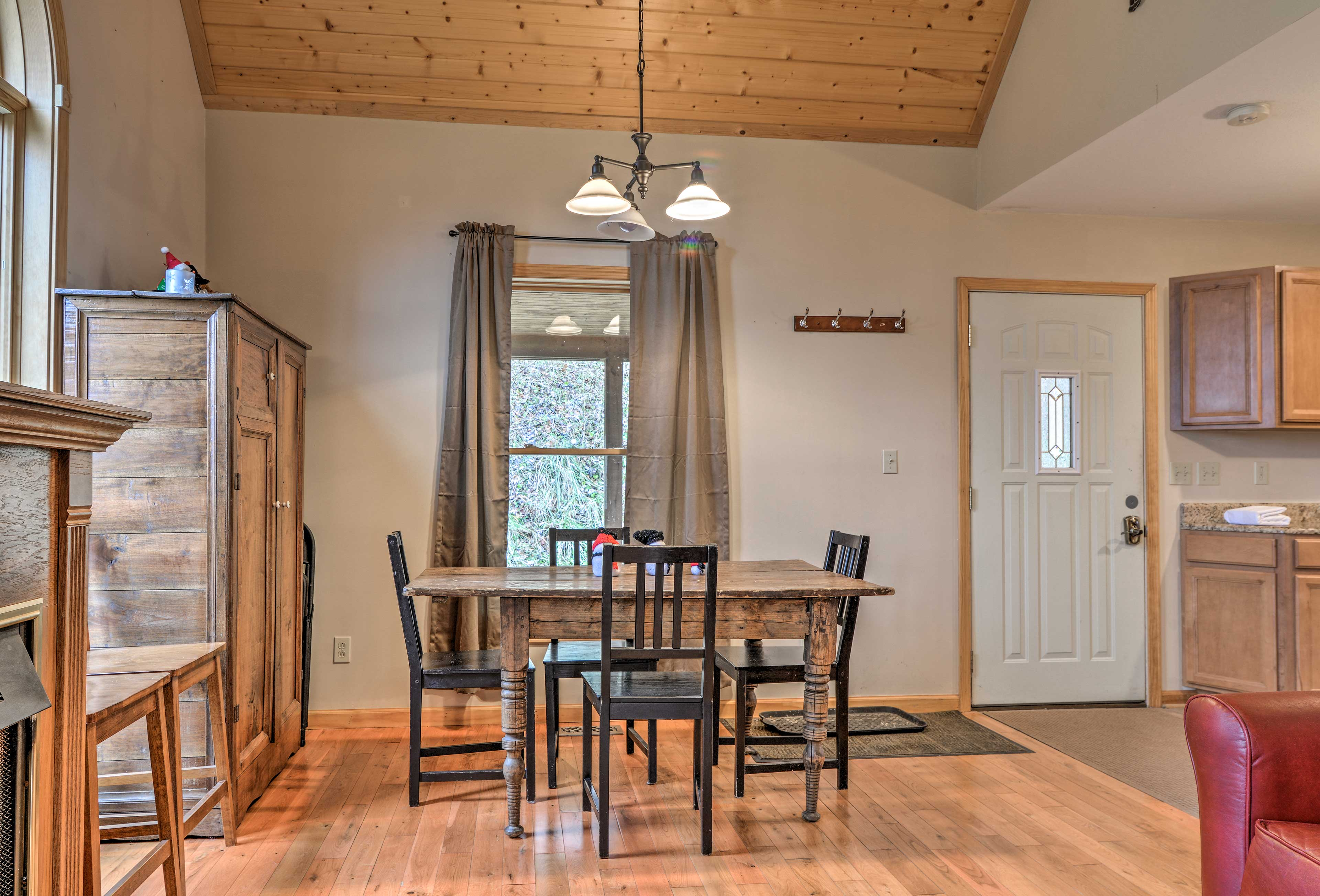 Dine in an abundance of natural light with windows framing the 4-seat table.