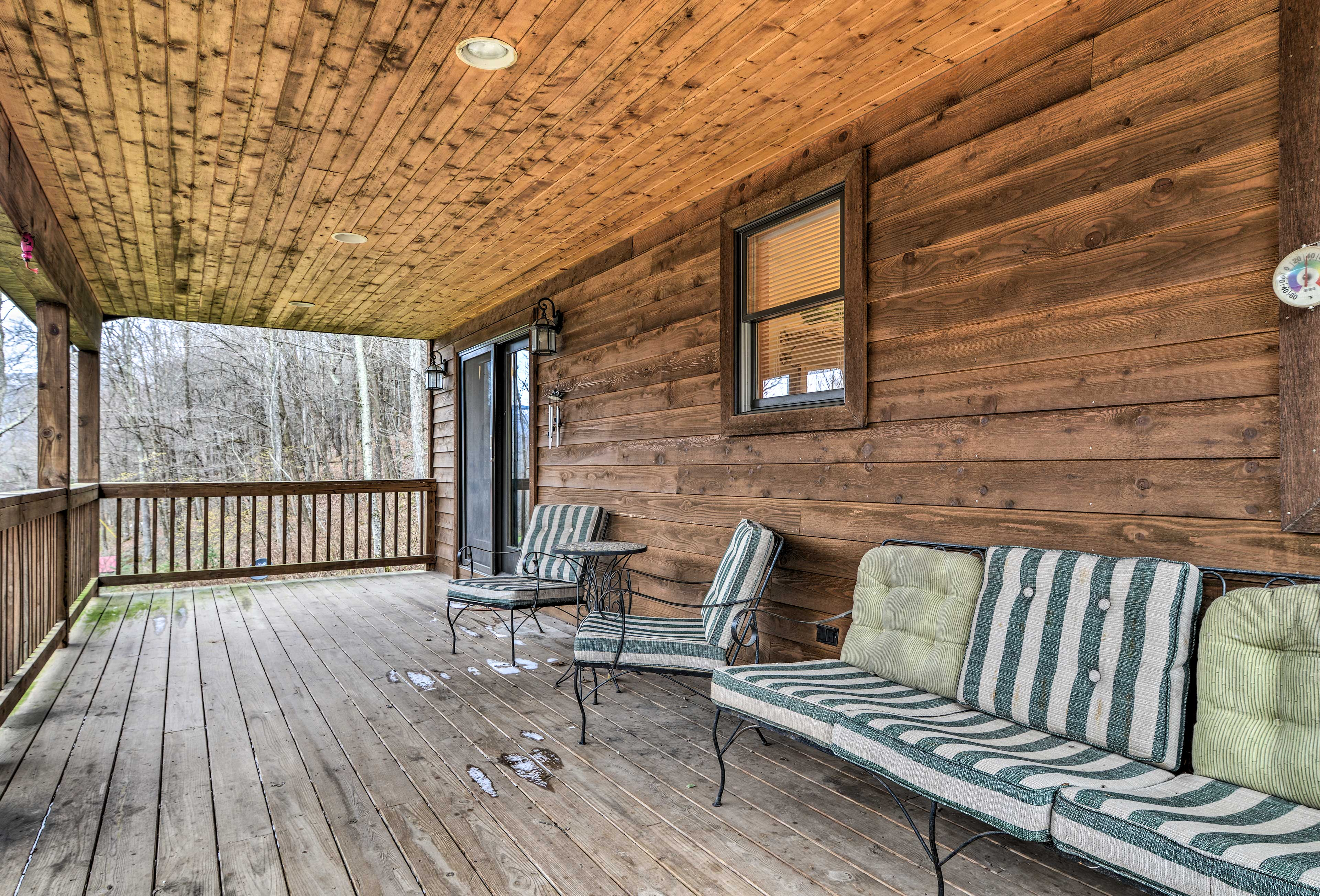 Wake up with a cup of coffee on the spacious porch overlooking the trees.