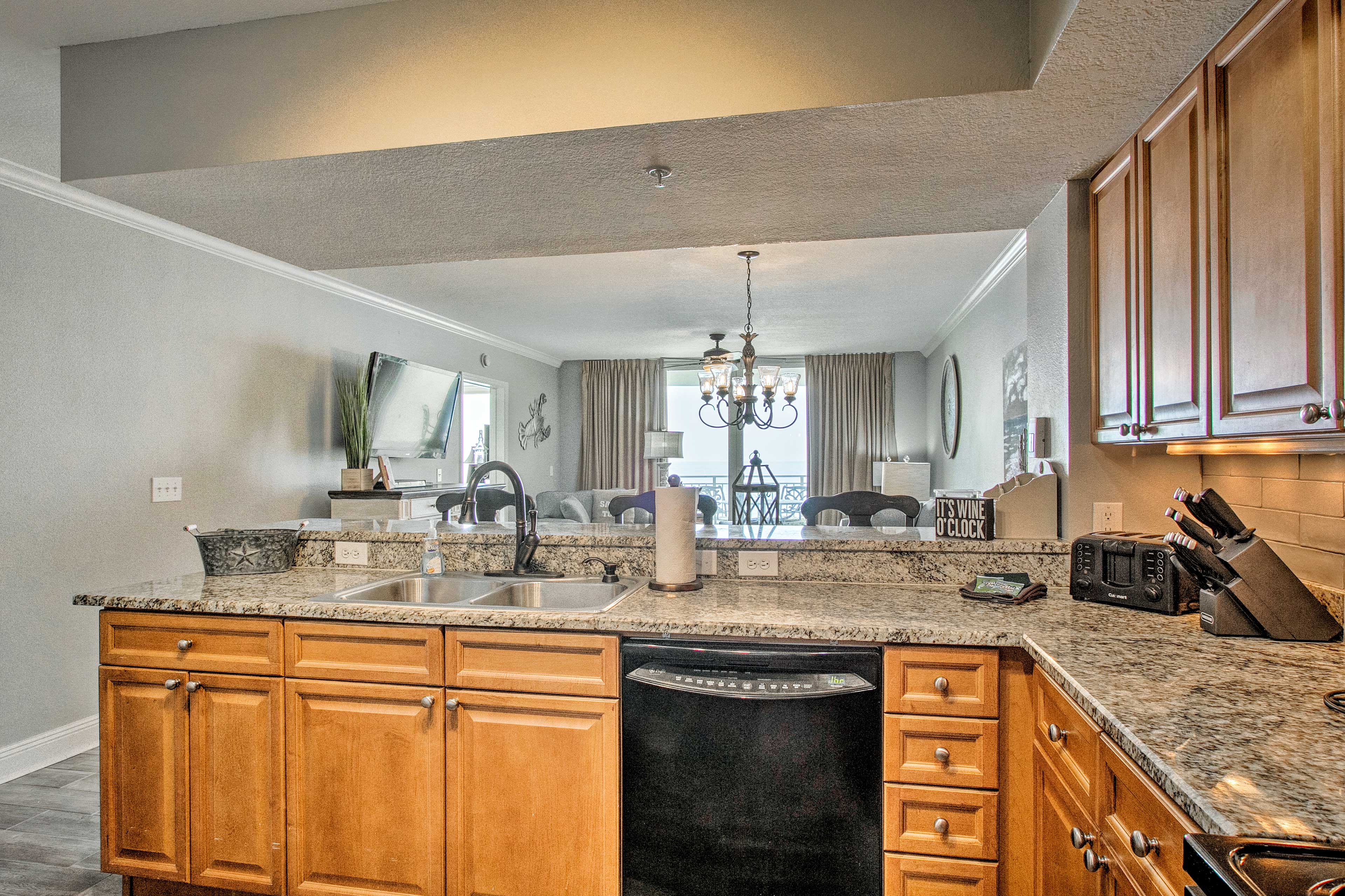 Admire the granite counters and all updated appliances.