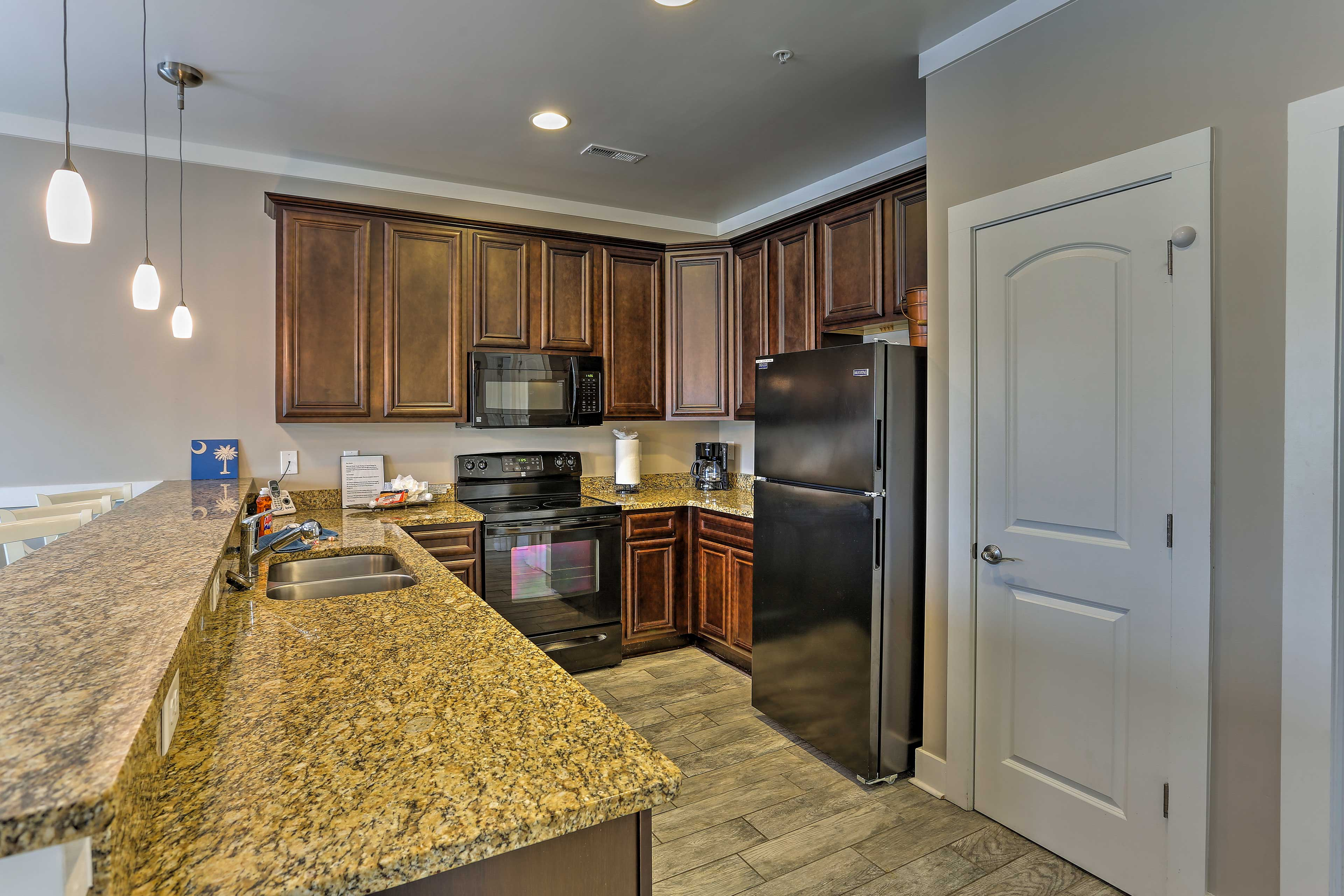 Ample granite counter tops make meal prepping a breeze.