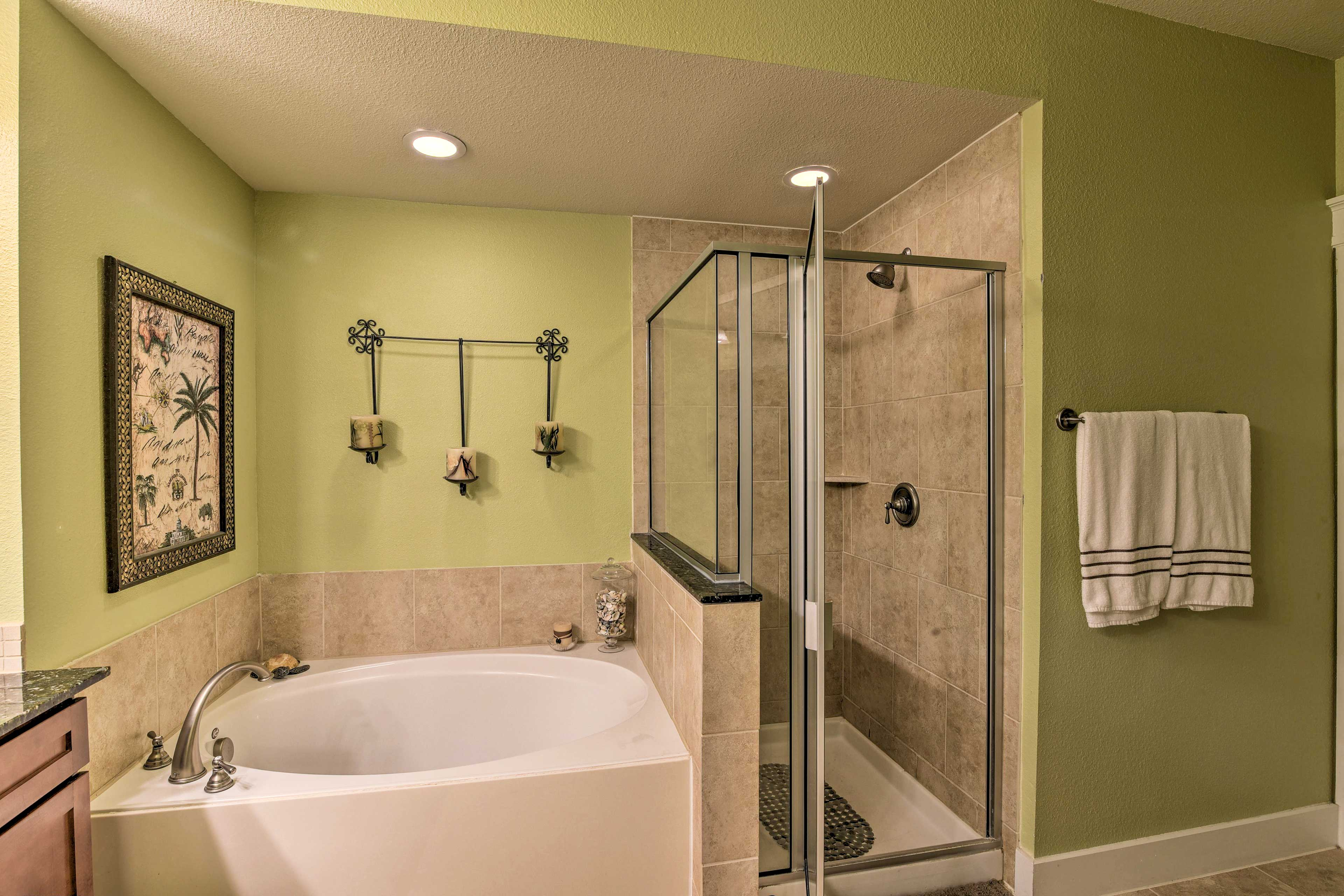 Take a relaxing rinse in the walk-in shower or soothing soak in the tub.