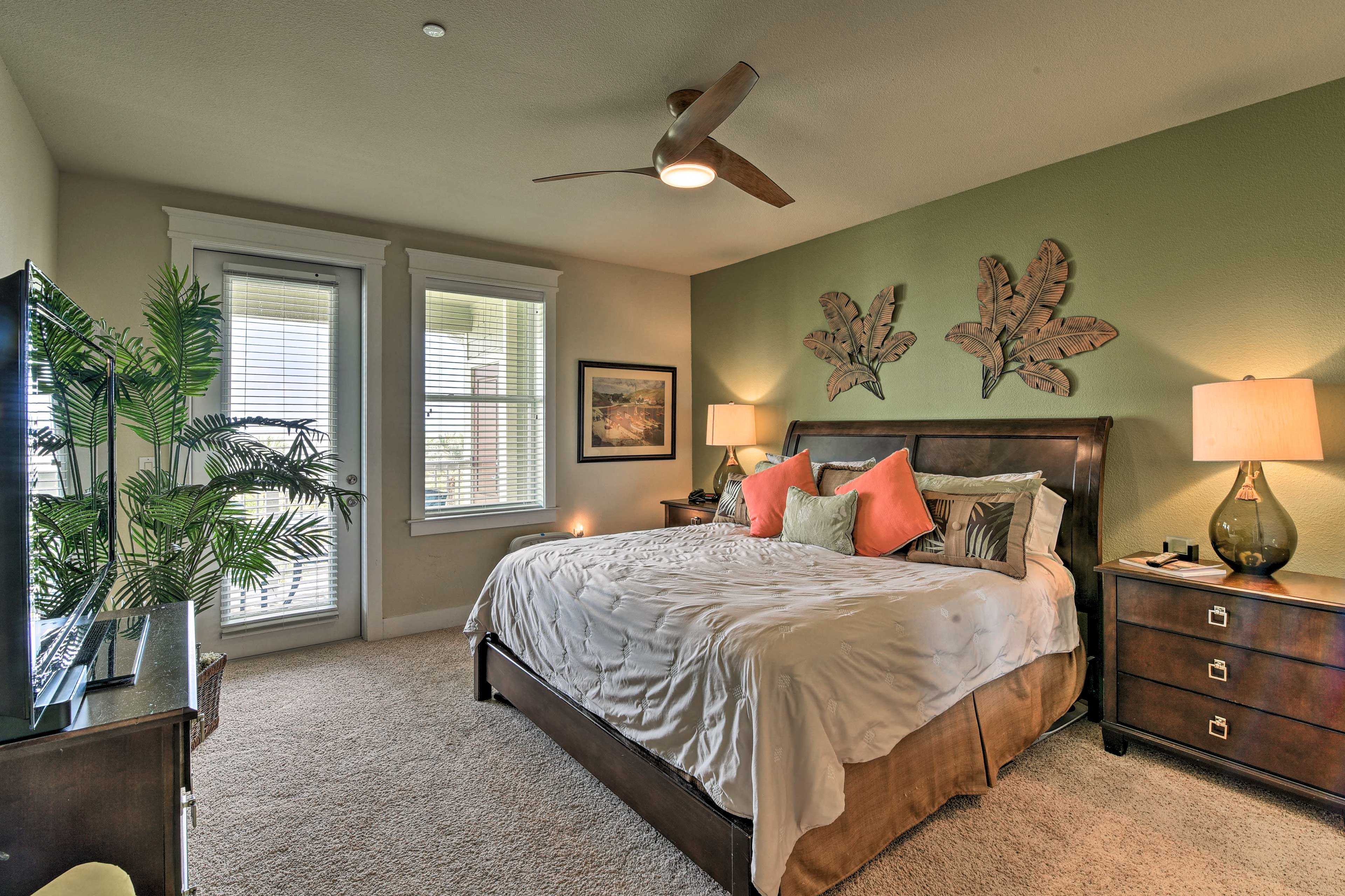 The master bedroom features access to the balcony and an en-suite bathroom.