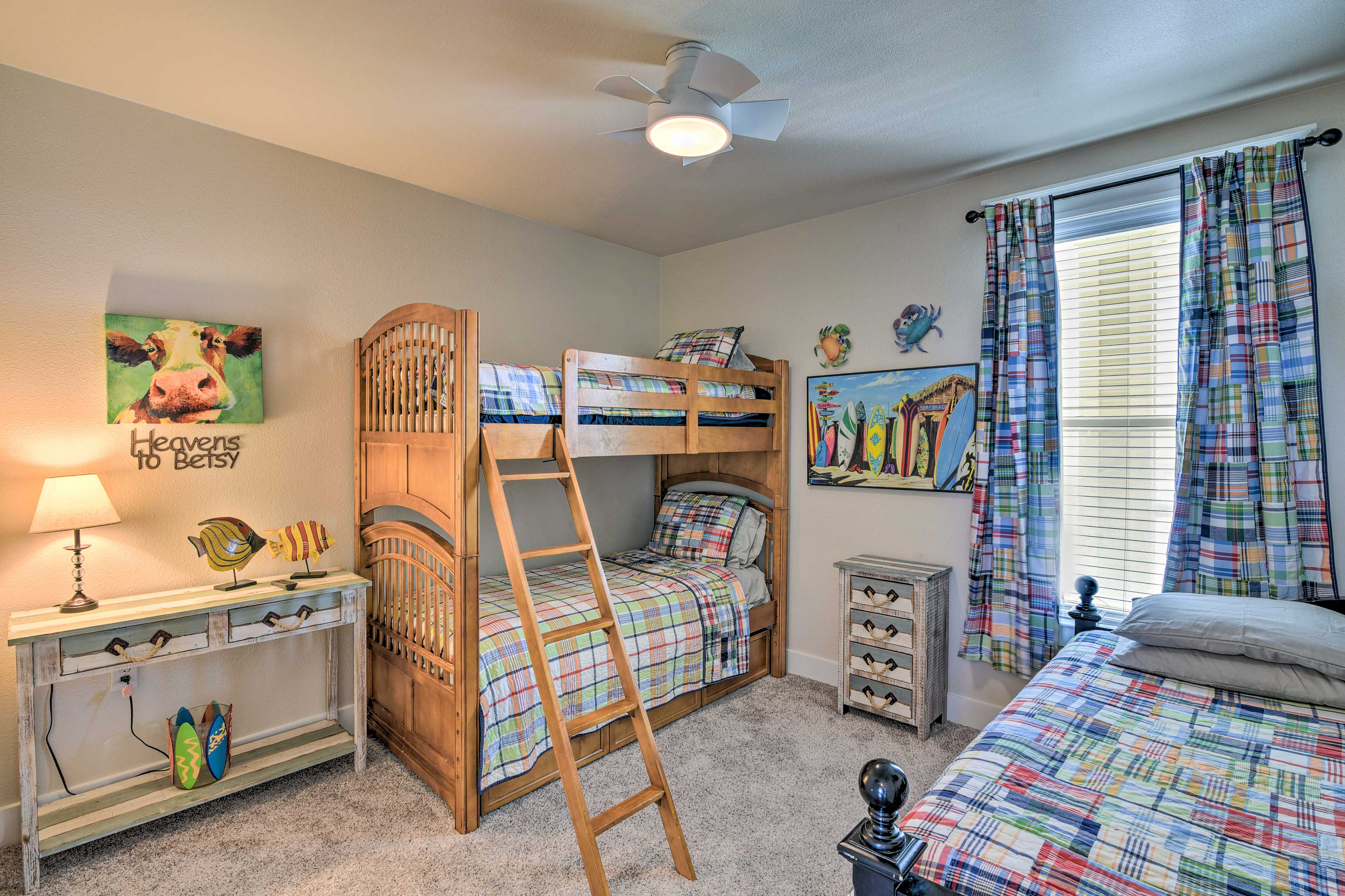 With a twin-over-twin bunk bed and a day bed this room sleeps 3.