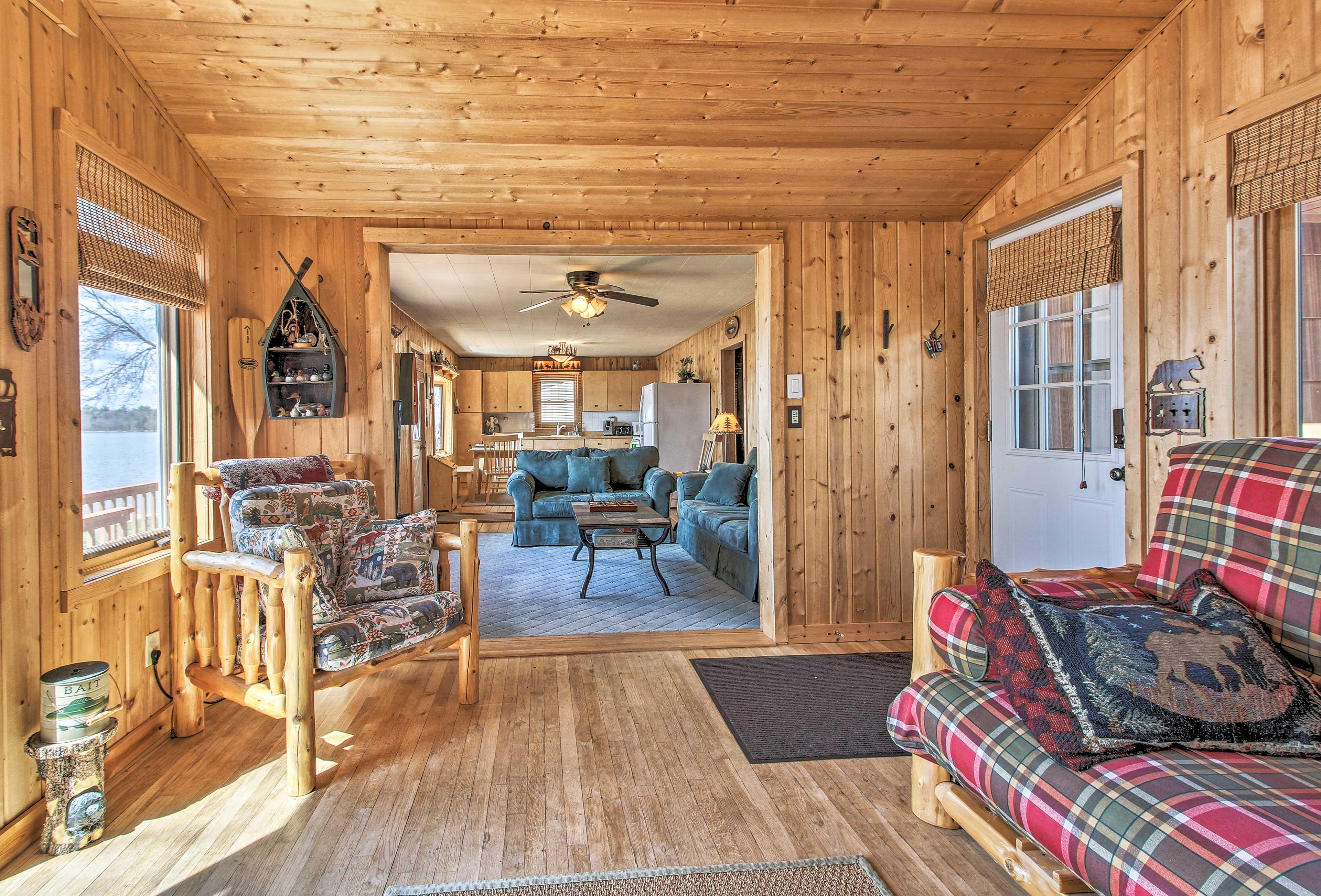 The four-season porch is cozy offering a futon to sleep on.