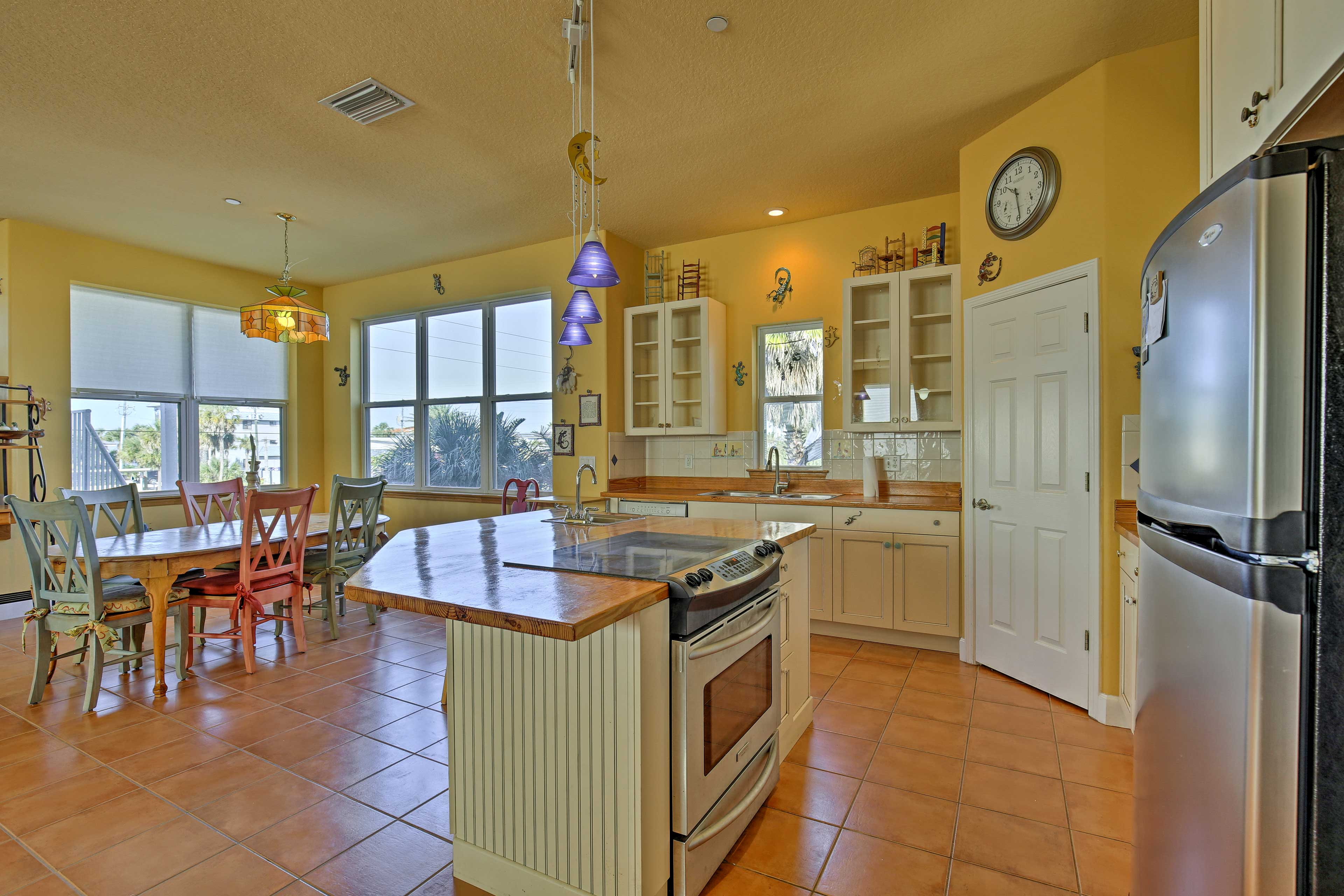 Serve appetizers at the kitchen island while dinner is prepared each evening.
