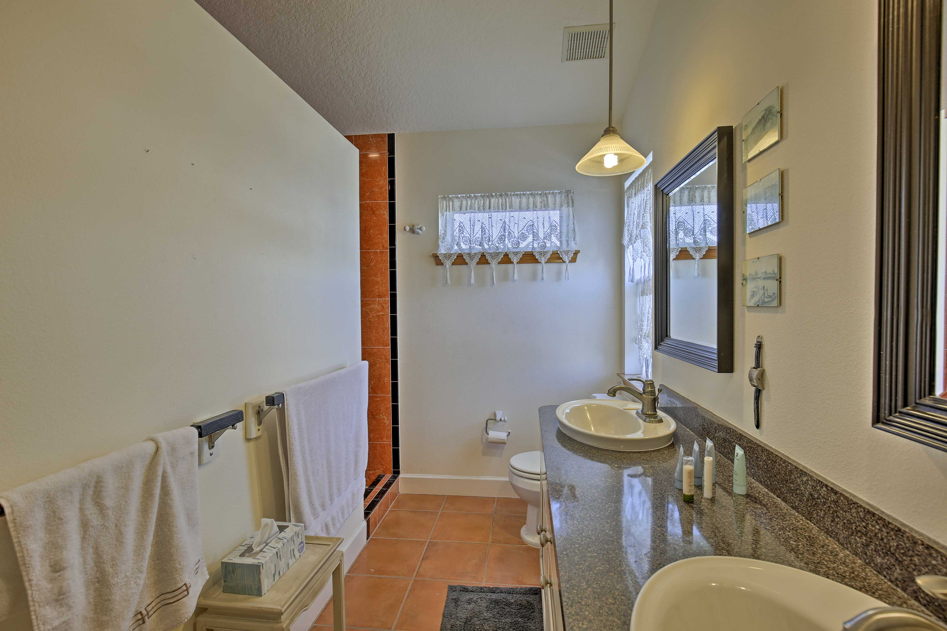 Wash up in the double vanity and walk-in shower in the master en-suite bathroom.