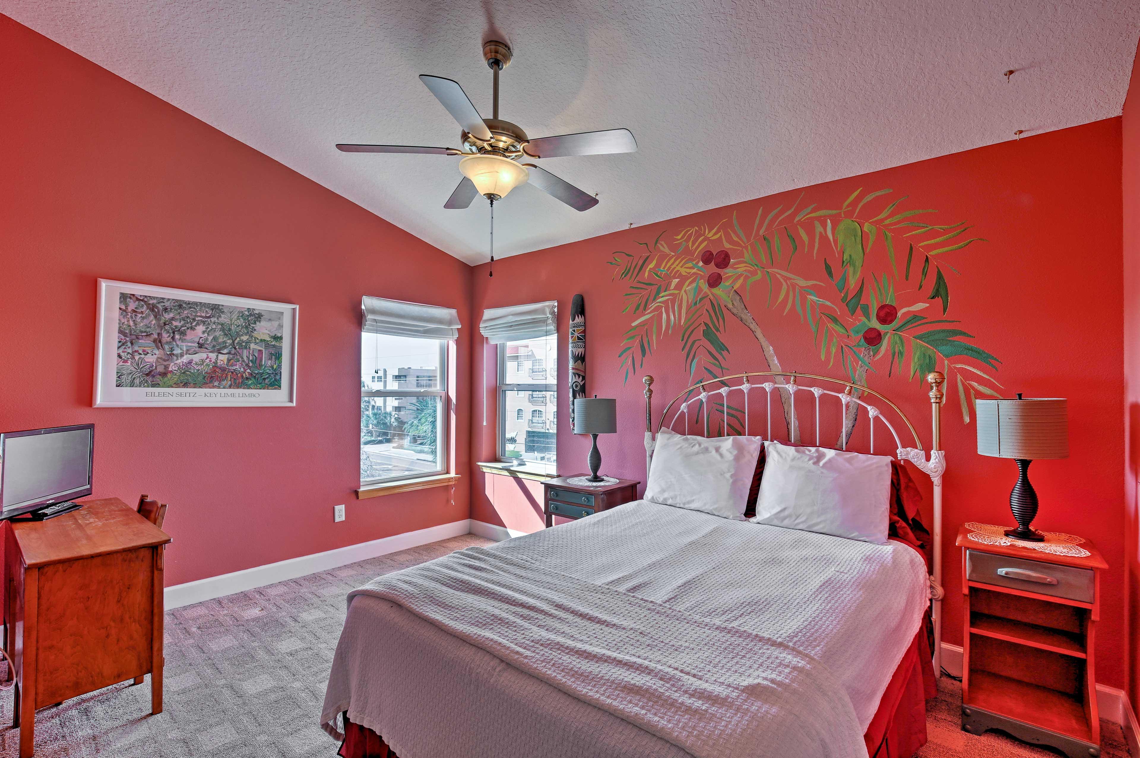 Rest easy on the queen bed in 'Crimson Chameleon' bedroom.
