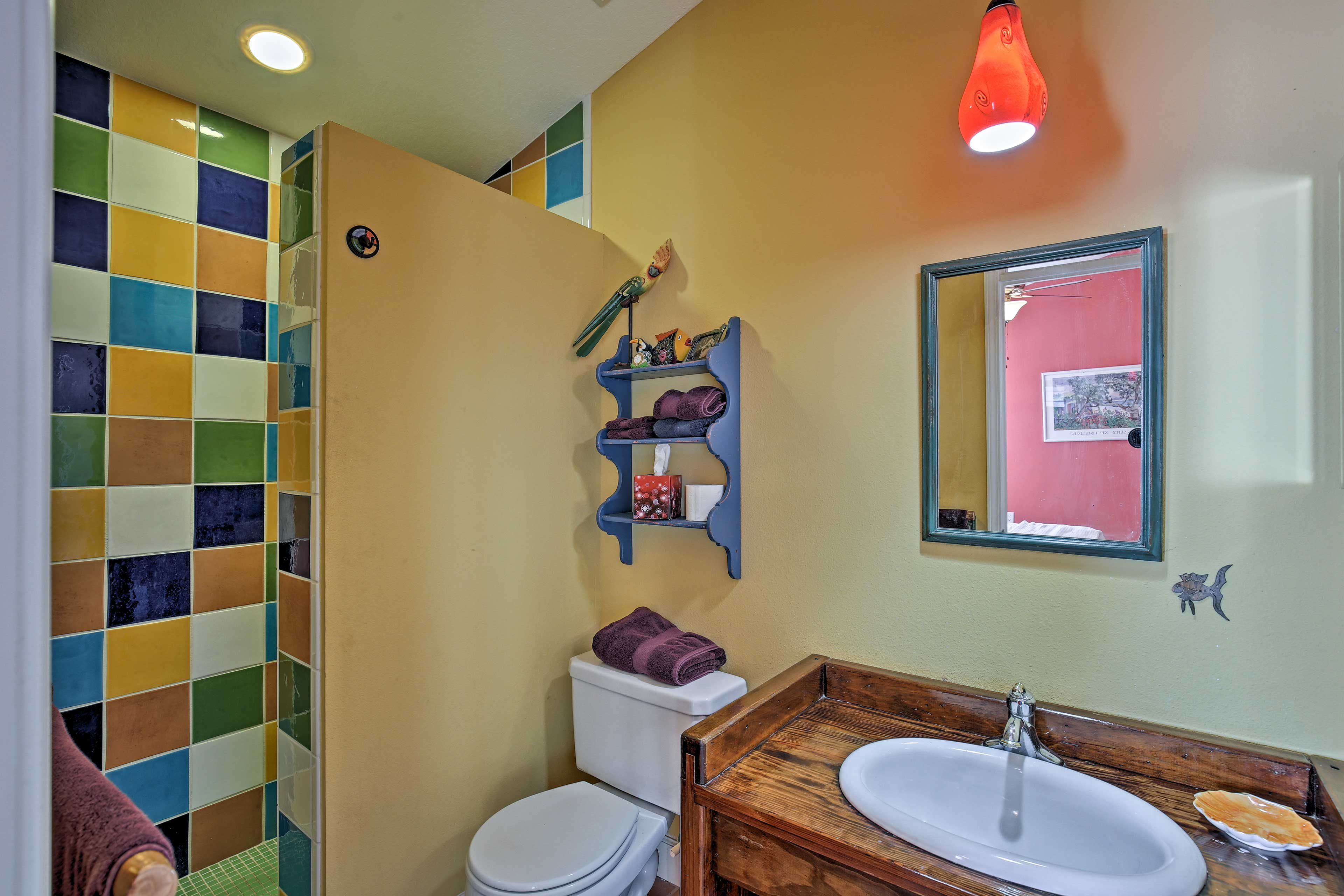 The second en-suite bathroom is equipped with a walk-in shower.