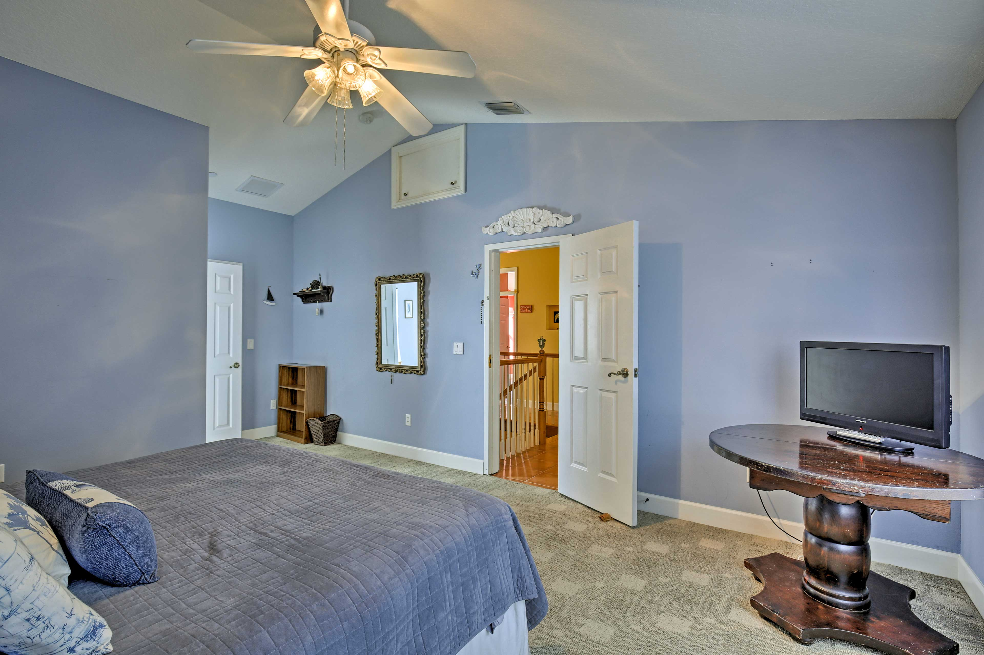 Lie back on the king bed and watch the flat-screen TV in the fourth bedroom.