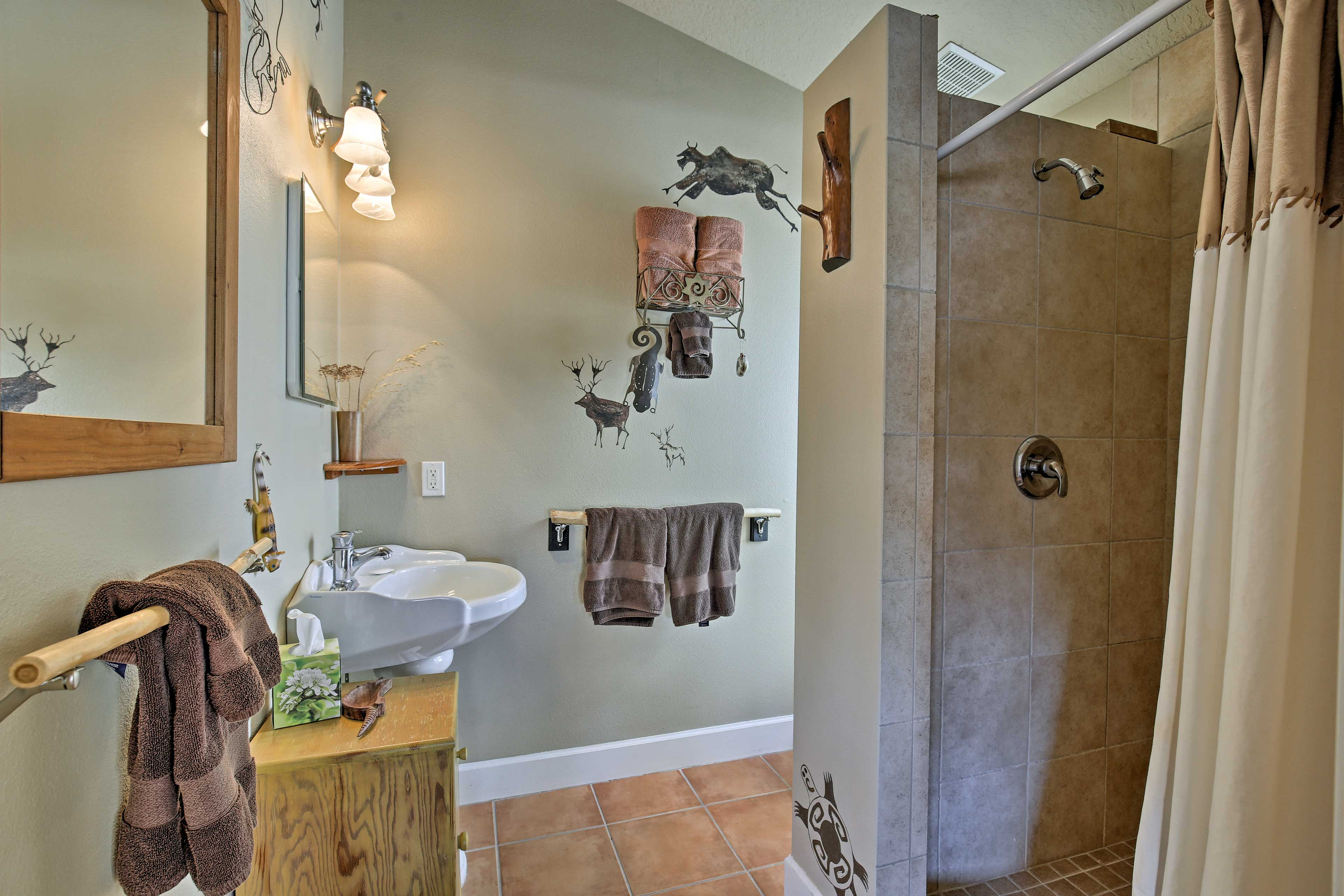Clean off in the third en-suite bathroom with a walk-in shower.