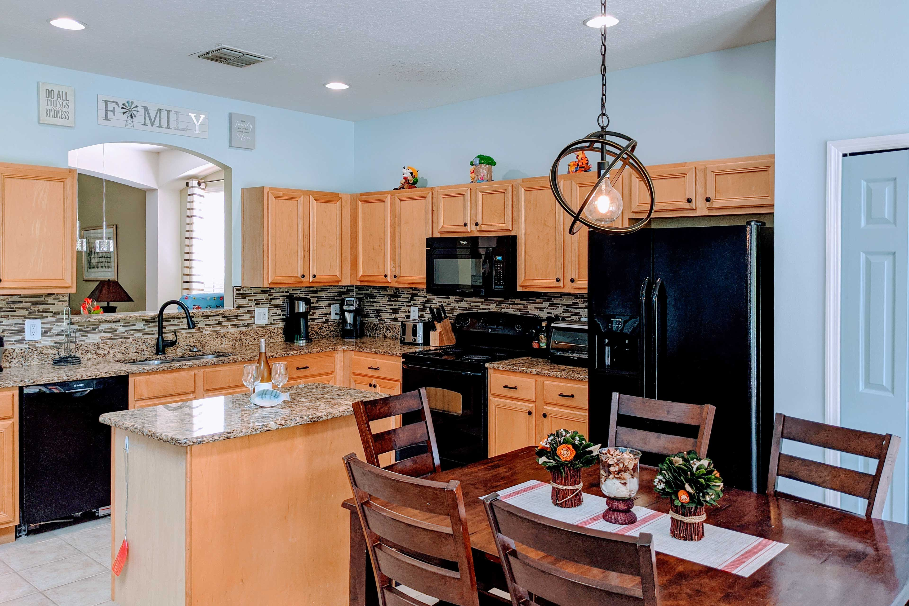 The kitchen is fully equipped and features granite counters.