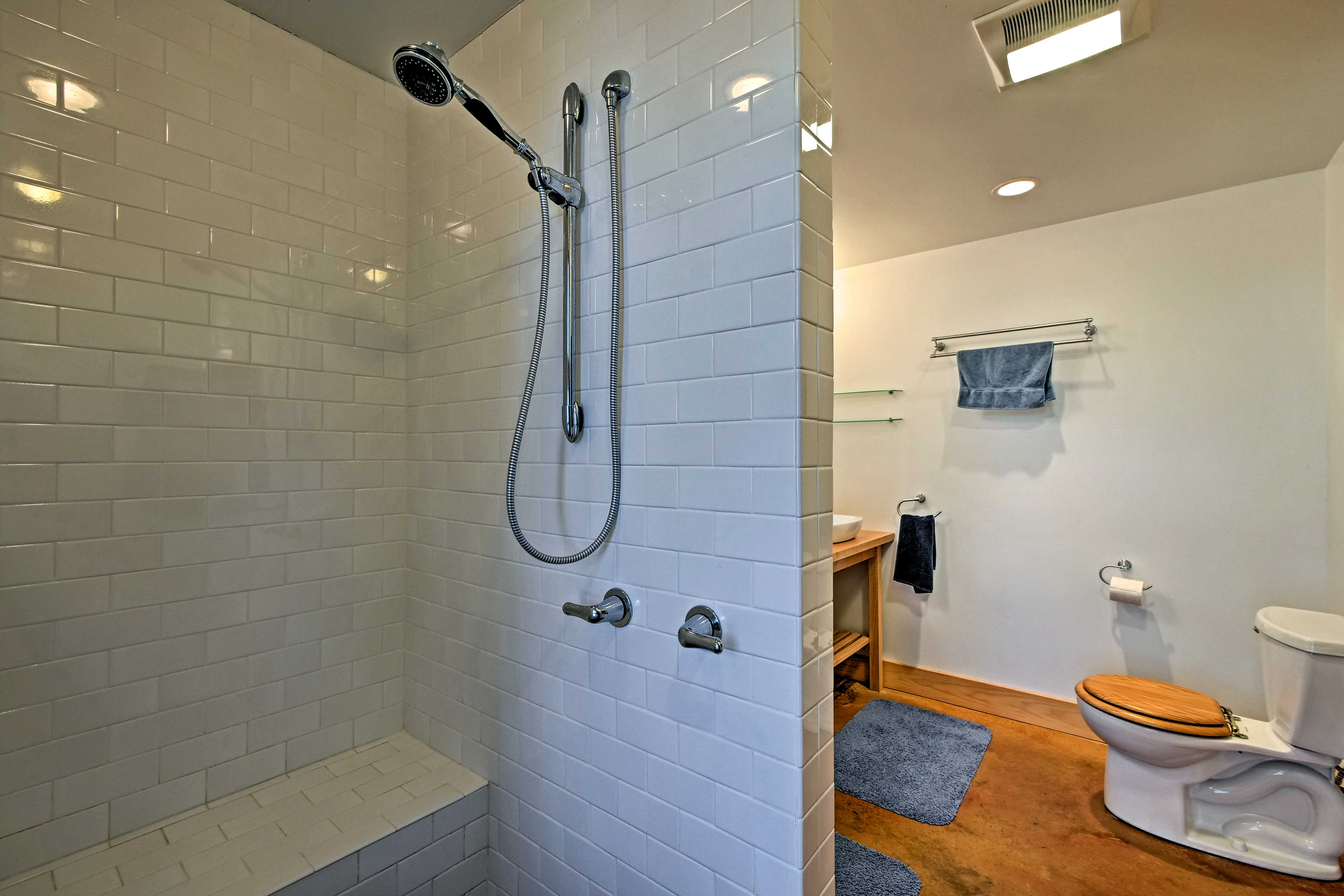 This unique walk-in shower is both modern and luxurious.