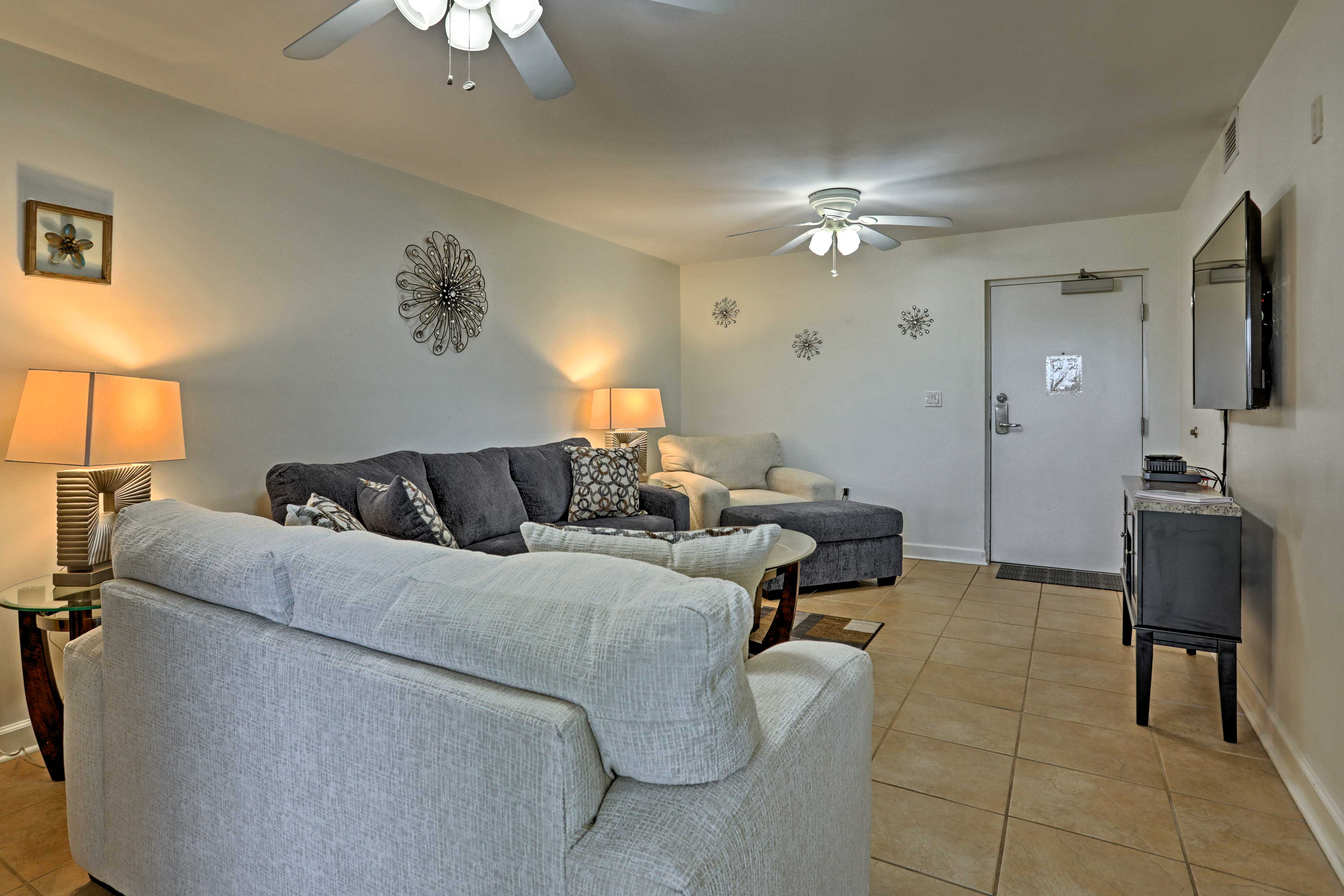 The living room is equipped with a flat-screen cable TV.