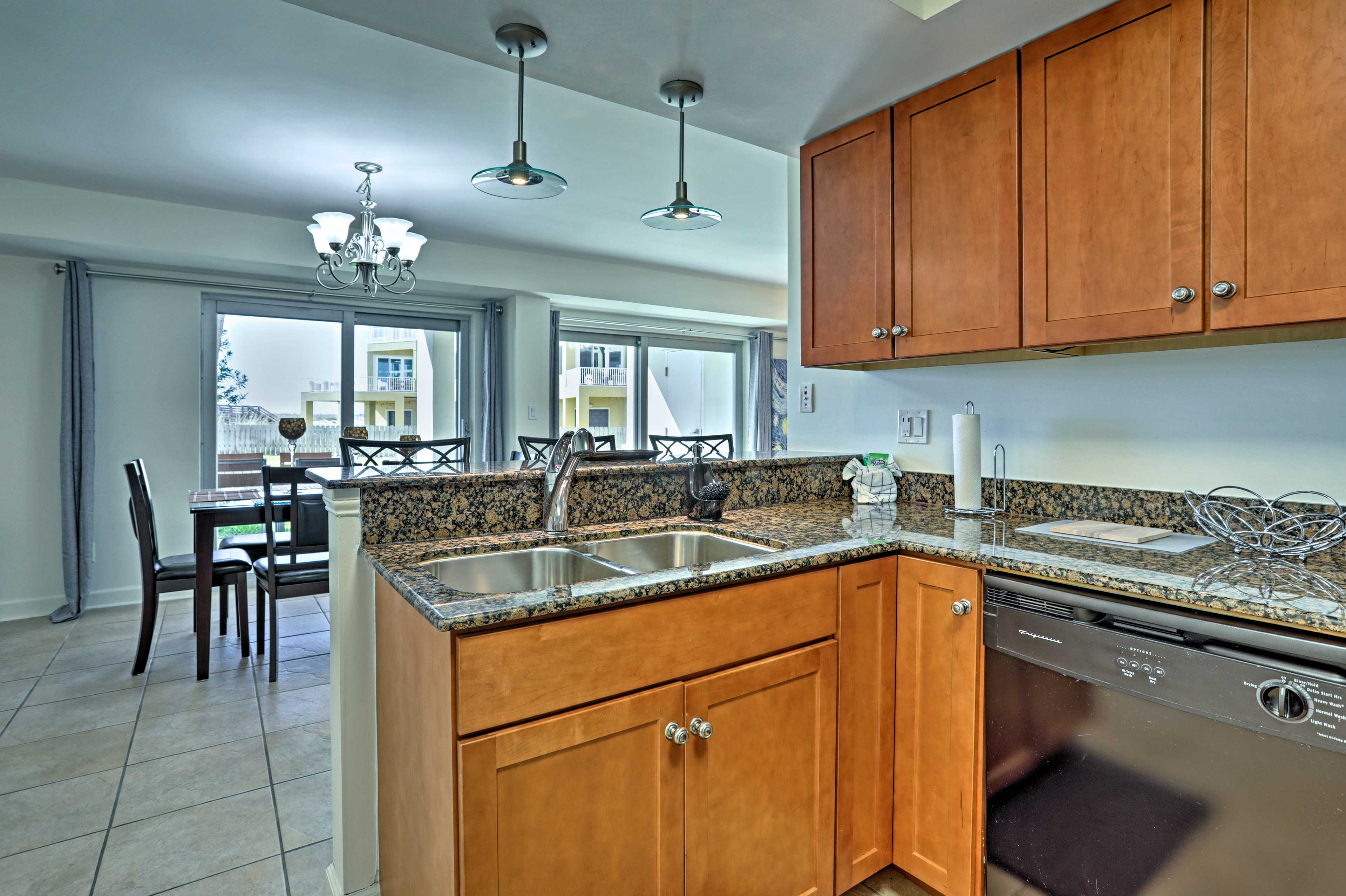 The fully equipped kitchen features granite countertops.
