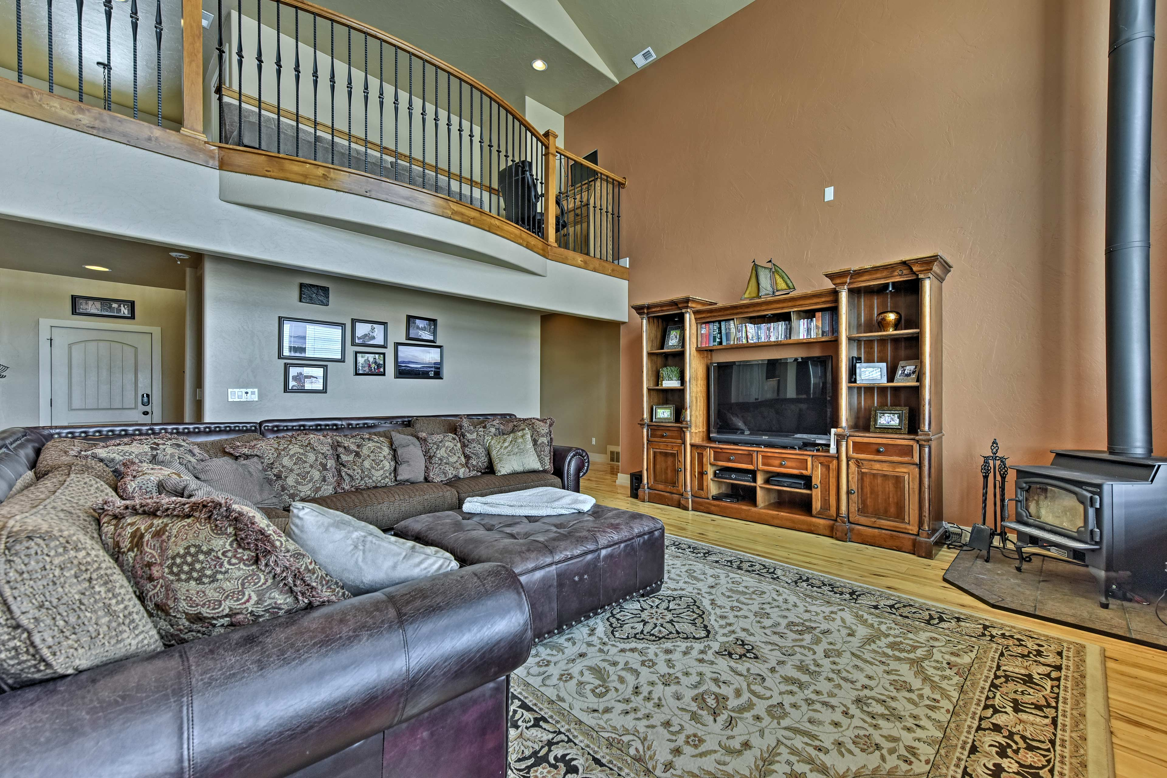 The upstairs living area is equipped with a flat-screen satellite TV.