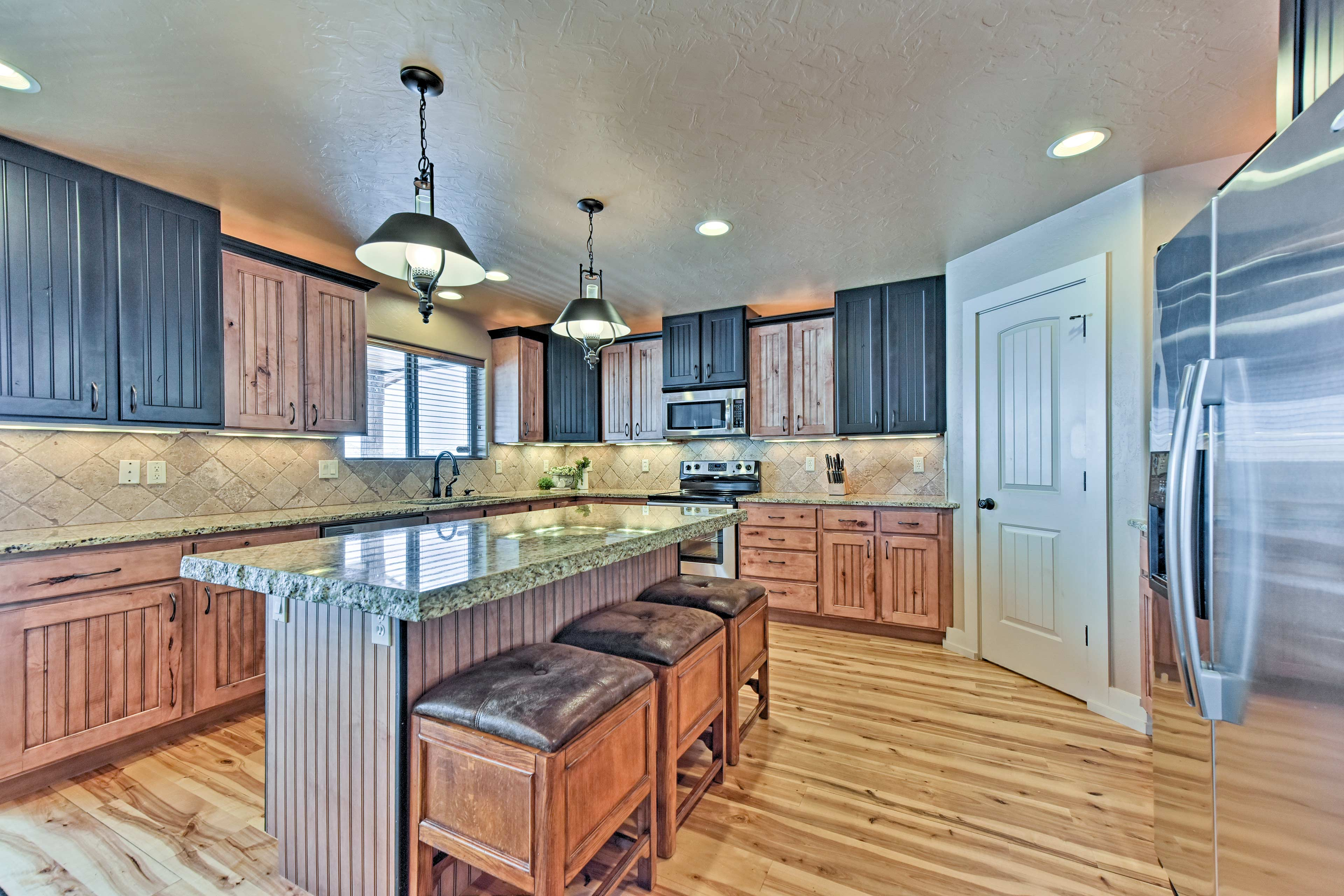 The fully equipped kitchen is large and luxurious.
