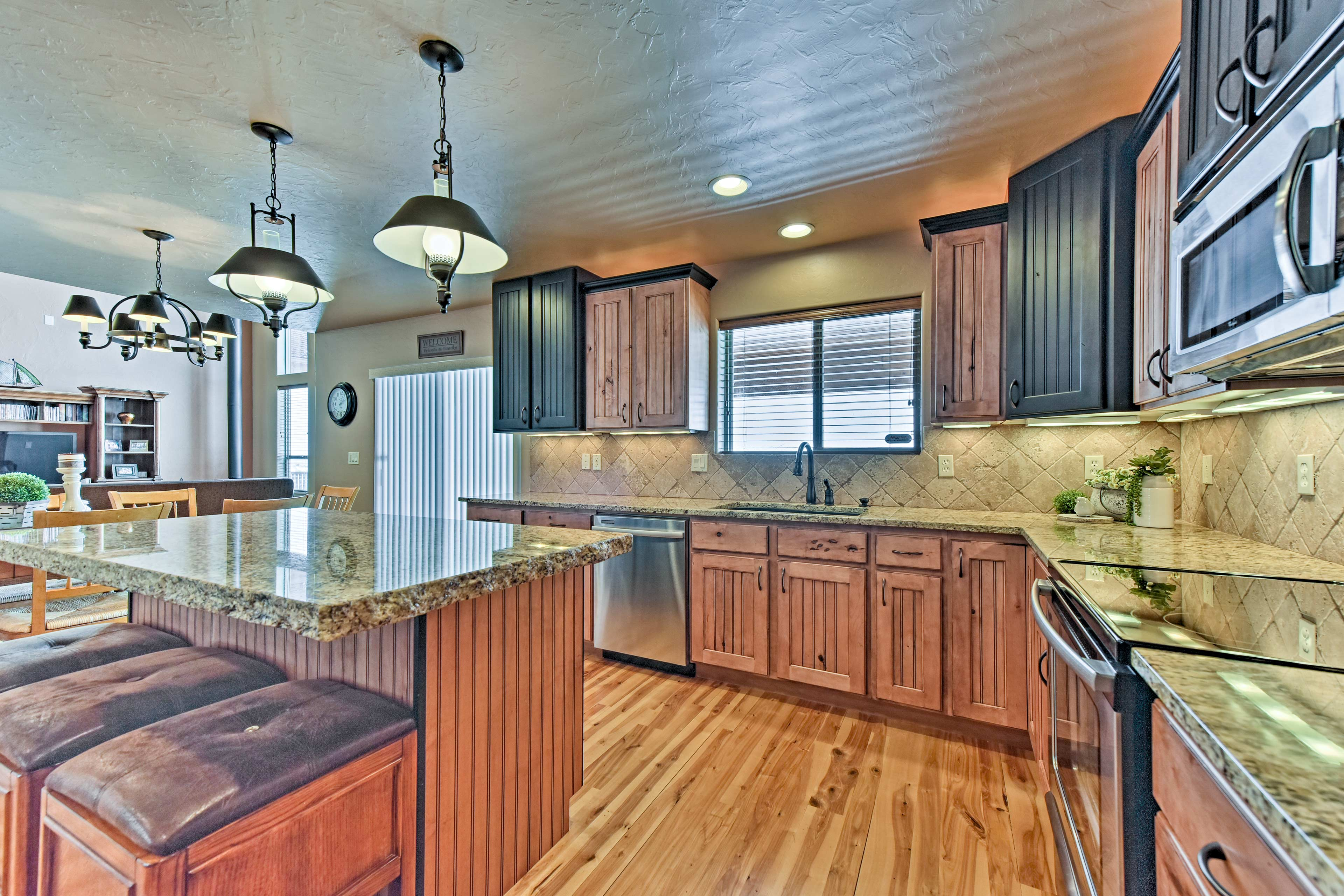 The kitchen boasts stainless steel appliances and granite countertops.