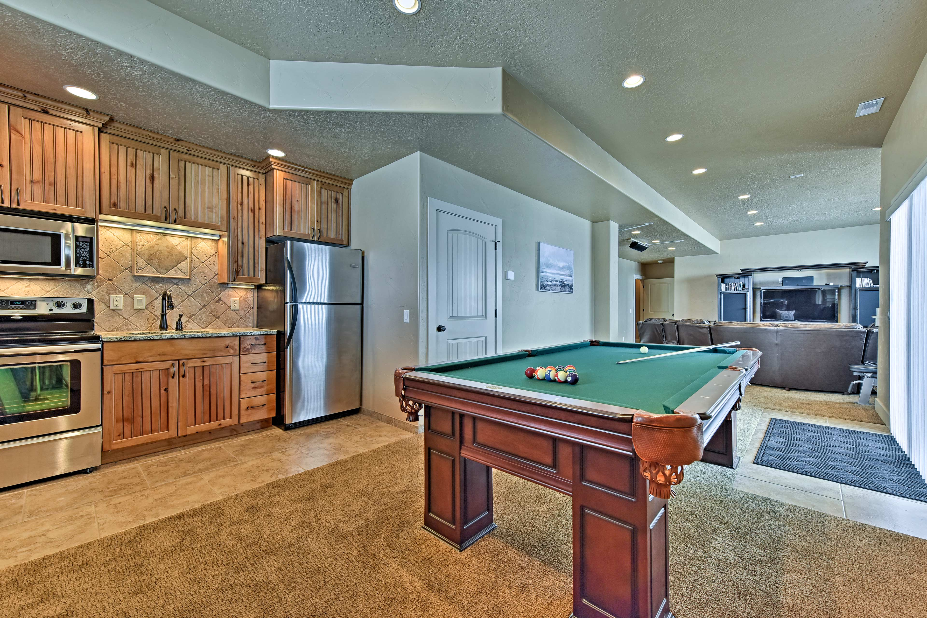 Host family game night around the pool table.