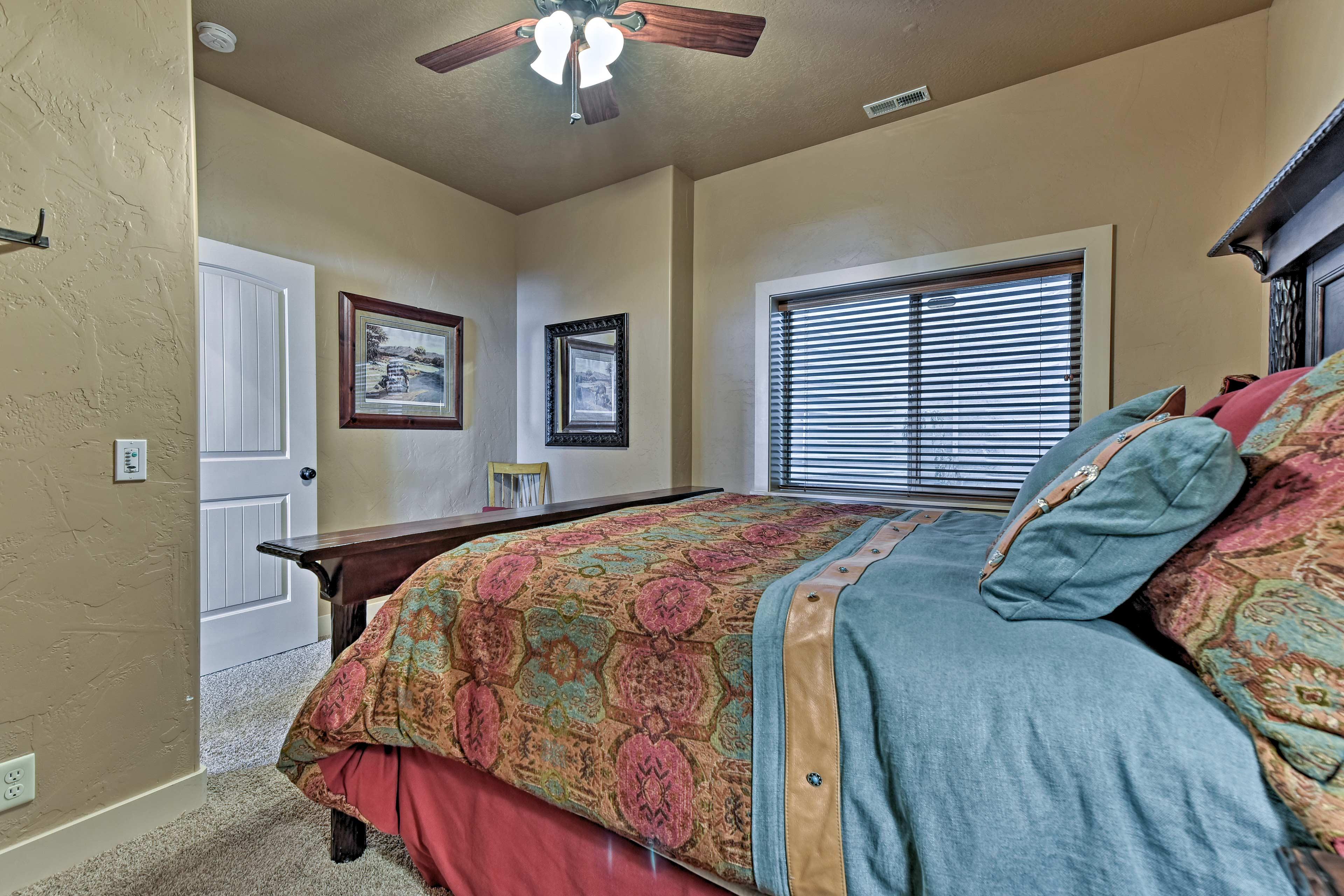 Bedroom 6 hosts a cozy queen bed.