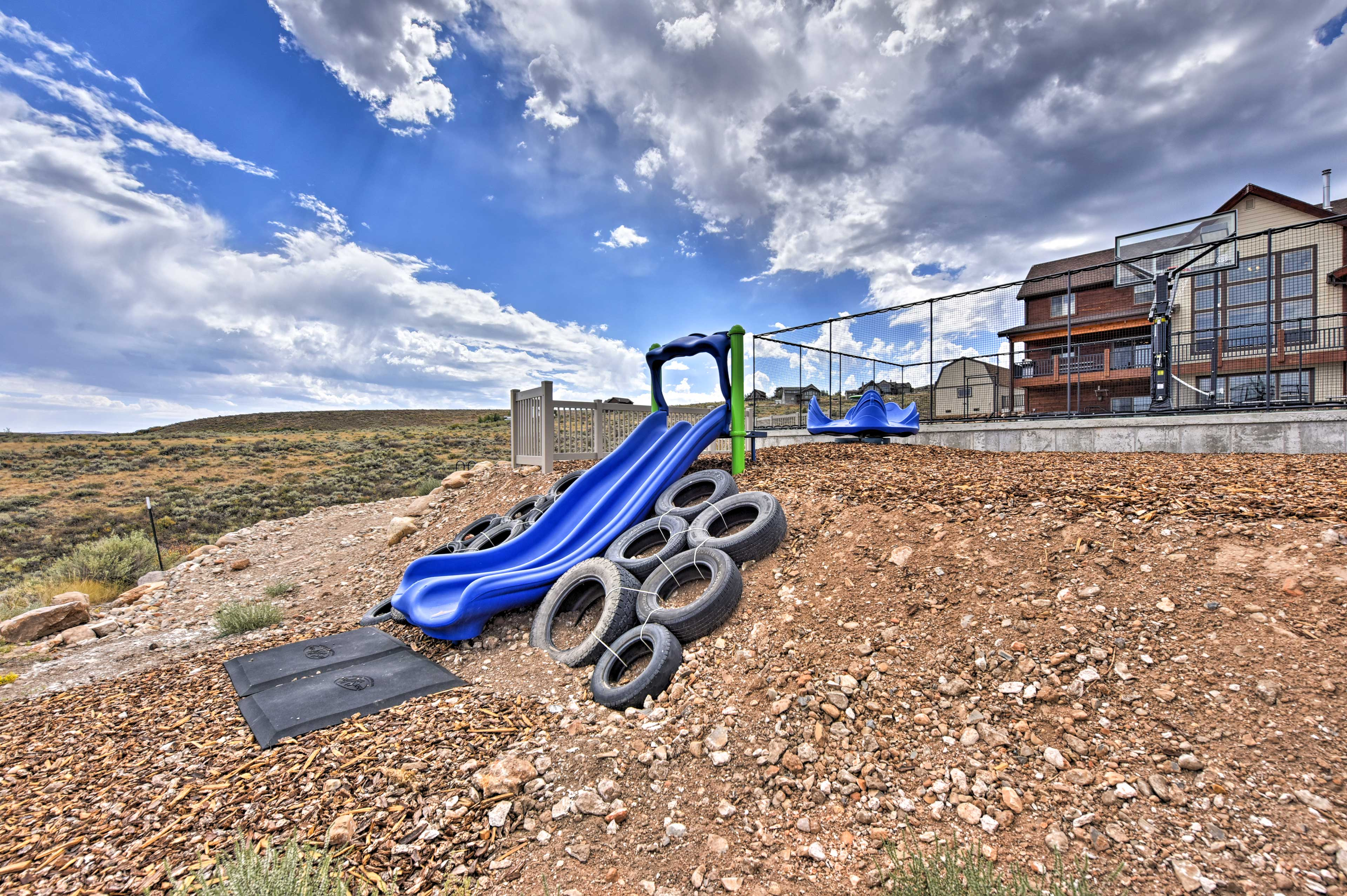 Let the kids climb up the tires and go down the slides!