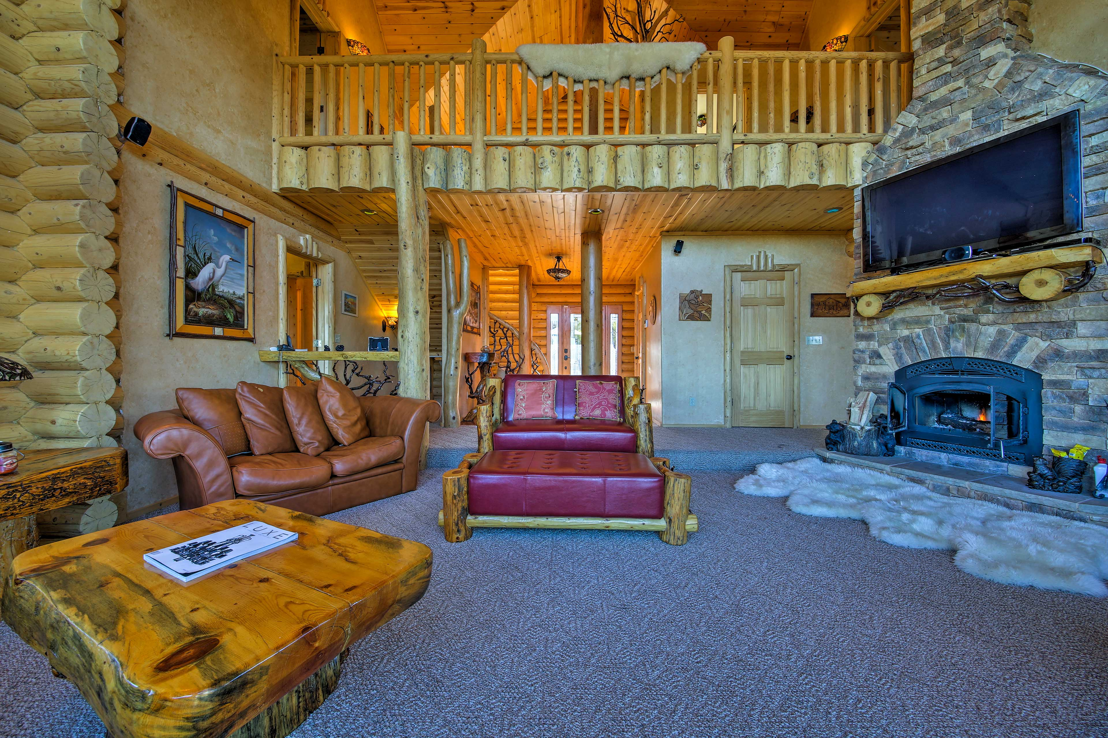 The interior features vaulted ceilings and is decorated with custom furniture.