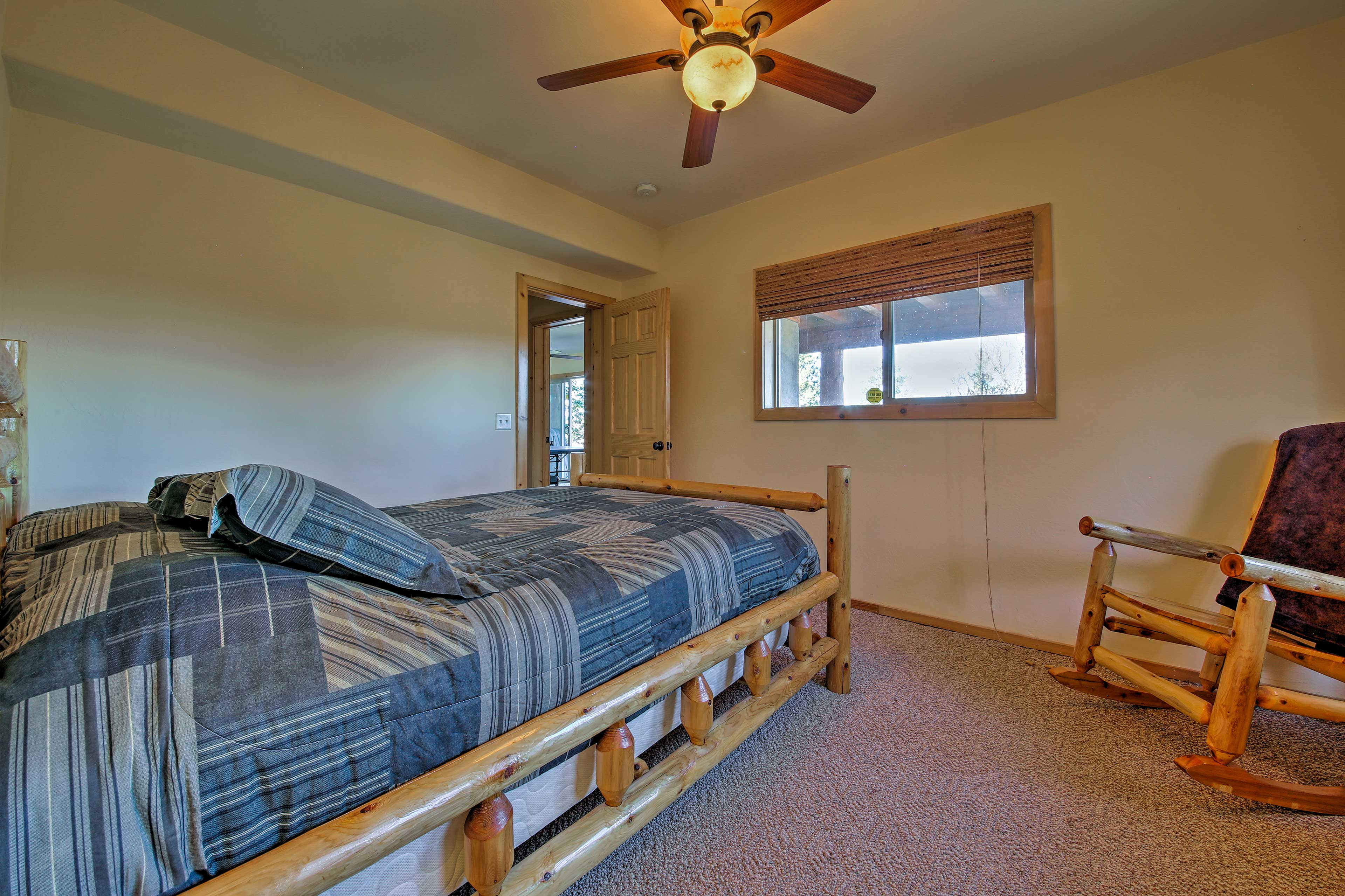 The lower level contains the 4th bedroom with a queen-sized bed.
