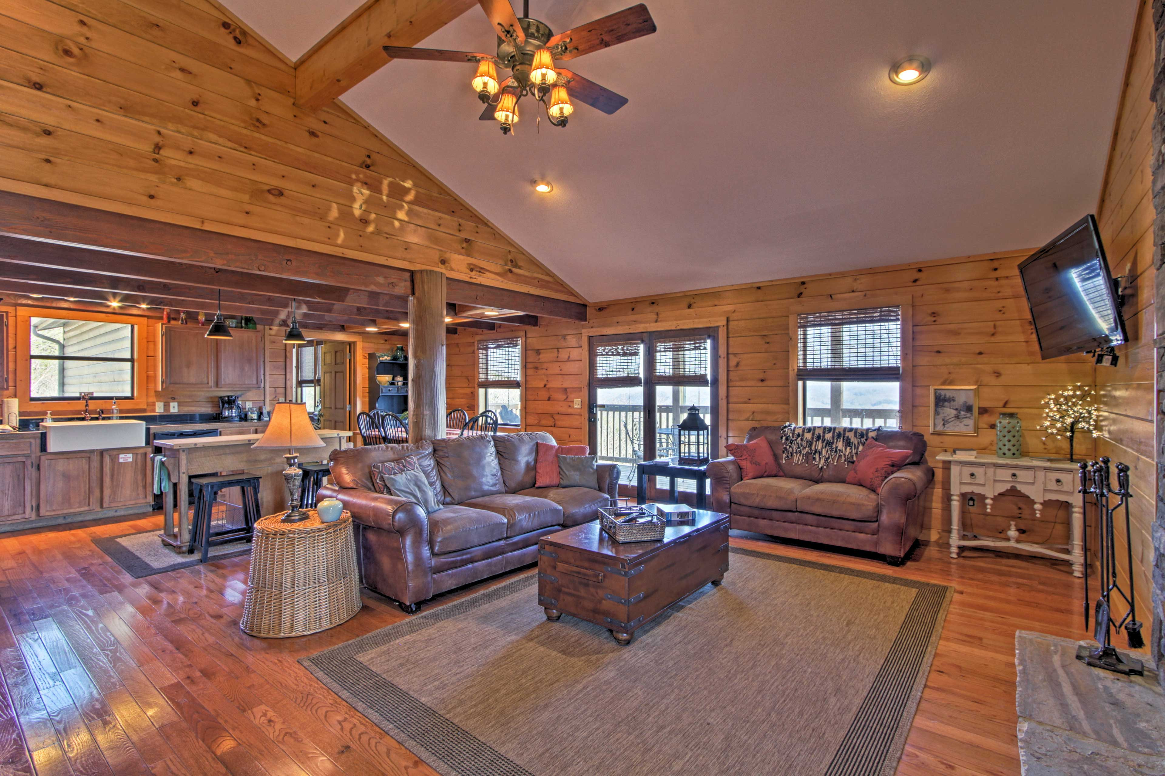Rustic furnishings and wood accents create a cozy cabin feel.