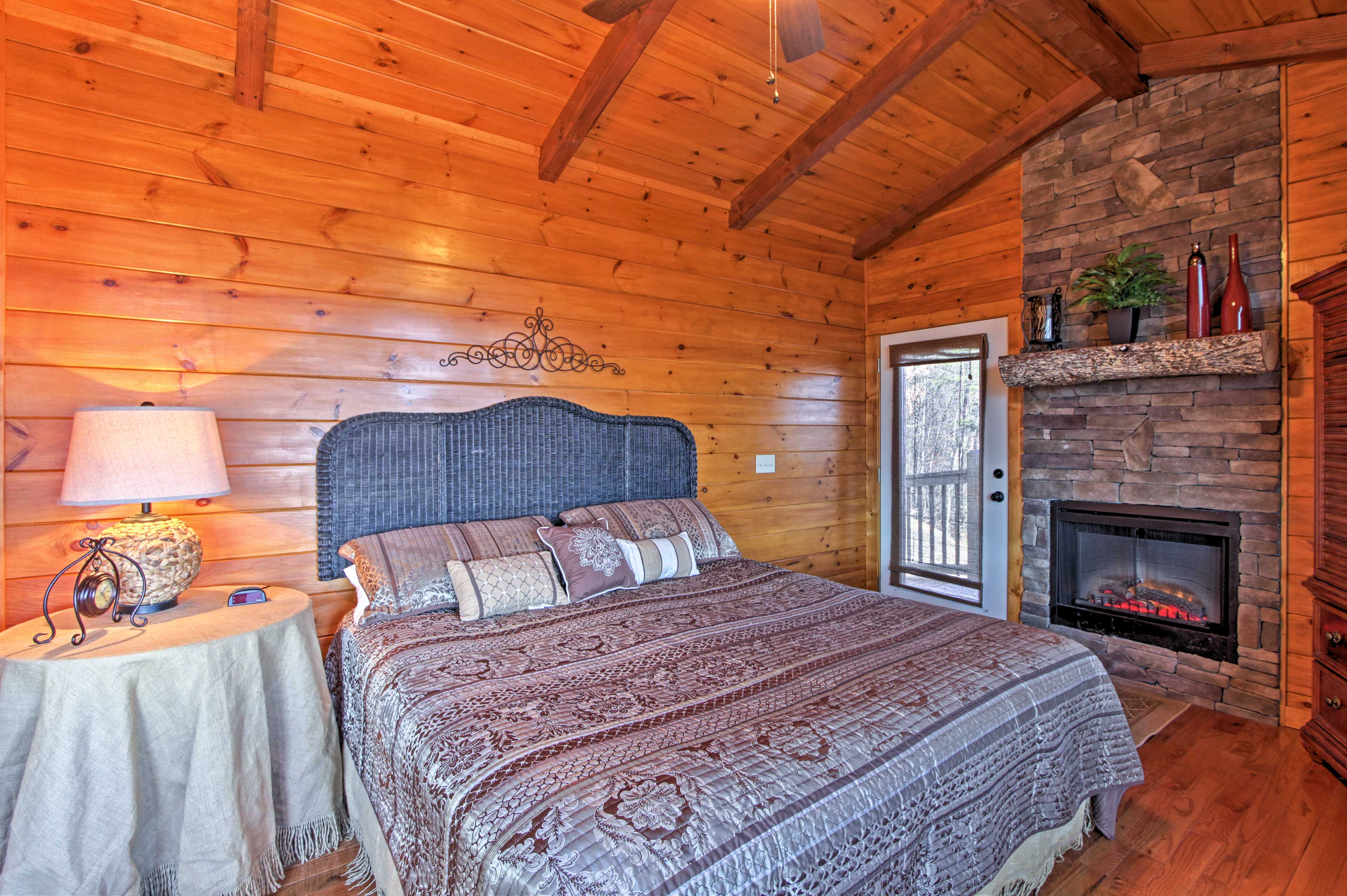 The first bedroom features a fireplace and large king bed.