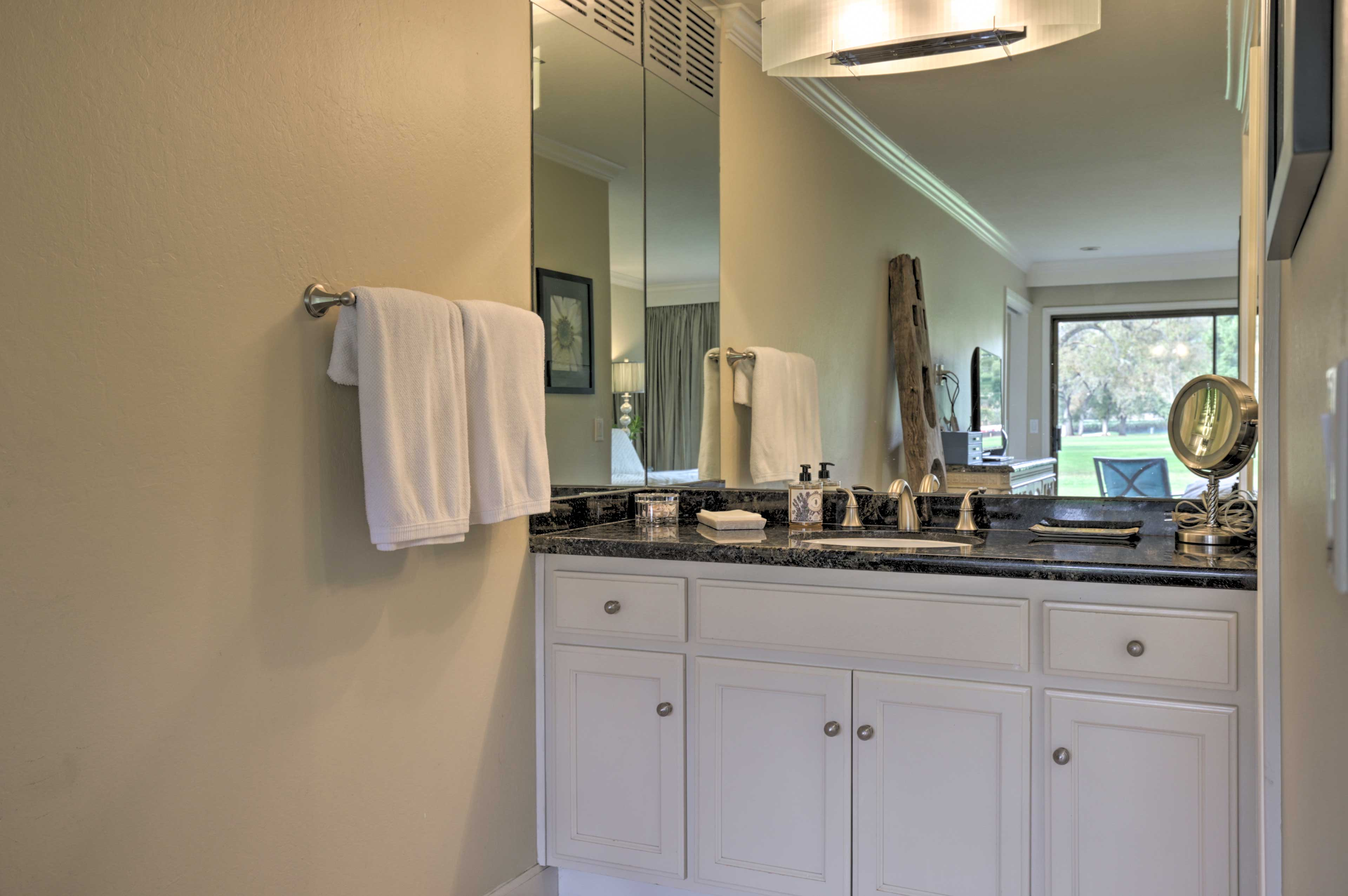 Get ready for the day in the pristine bathroom.