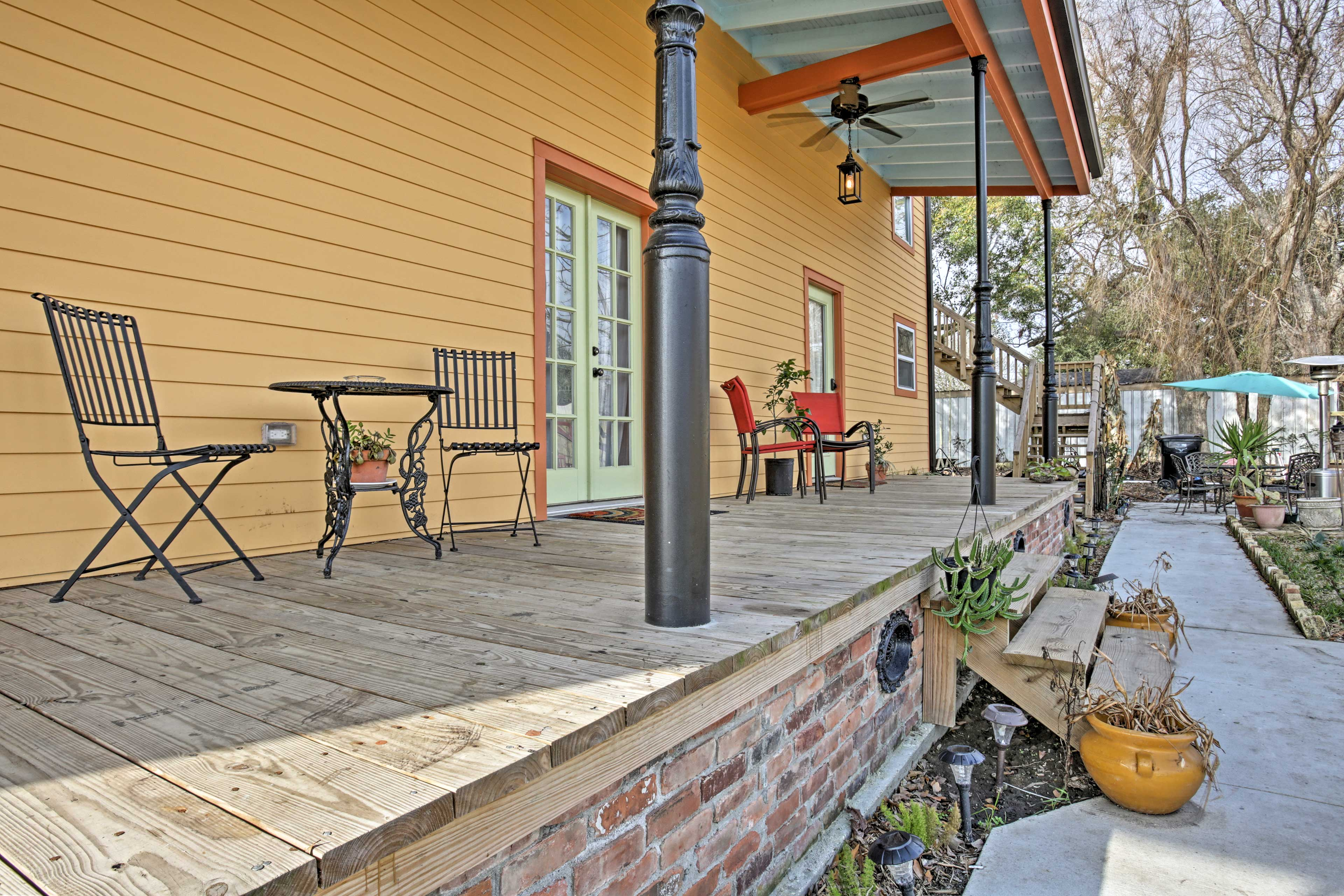 Enjoy a cup of coffee on the furnished porch before heading into New Orleans.