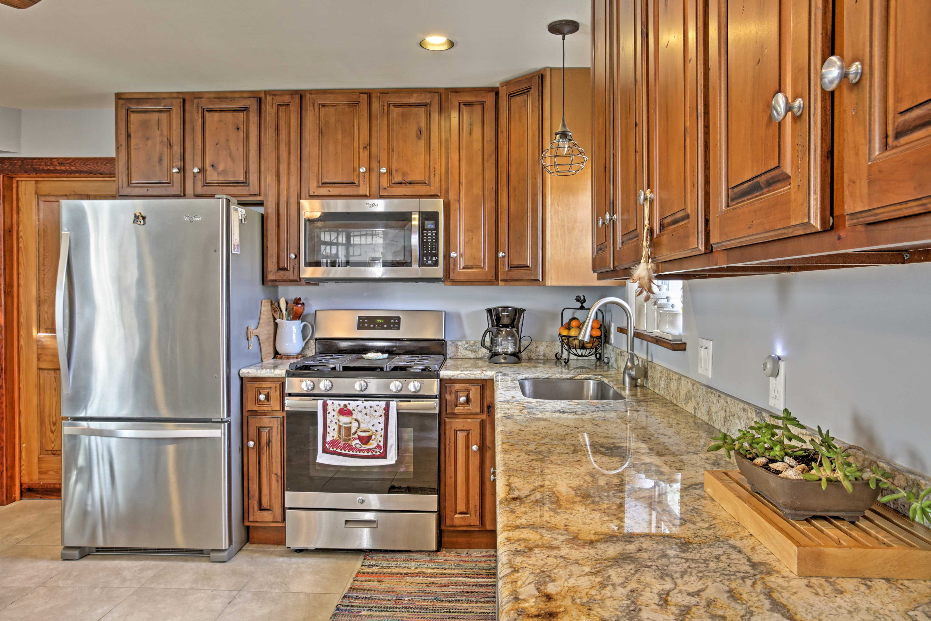 The fully equipped kitchen has granite counters and stainless steel appliances.
