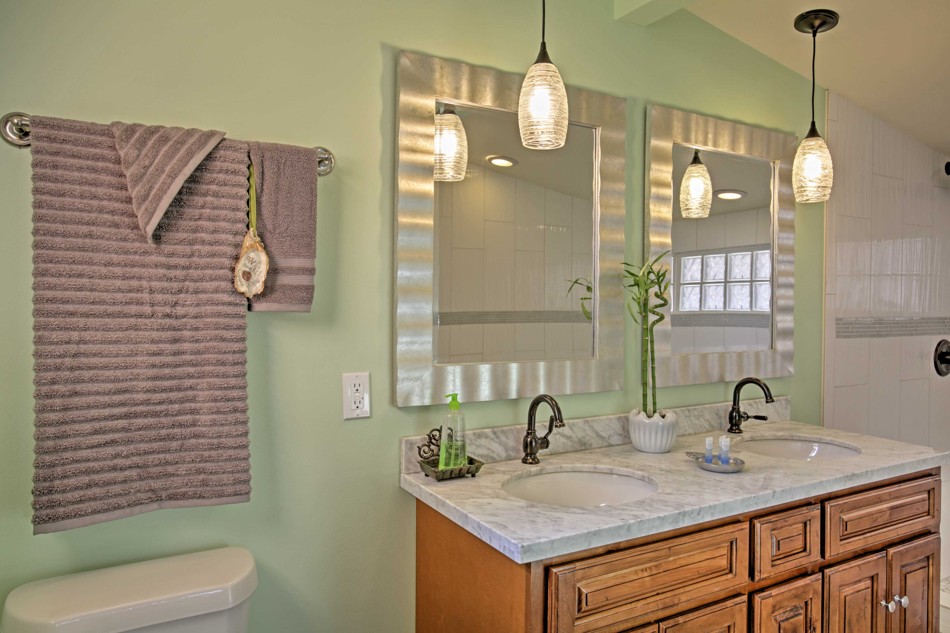 Both of the home's bathrooms feature granite countertops and walk-in showers.