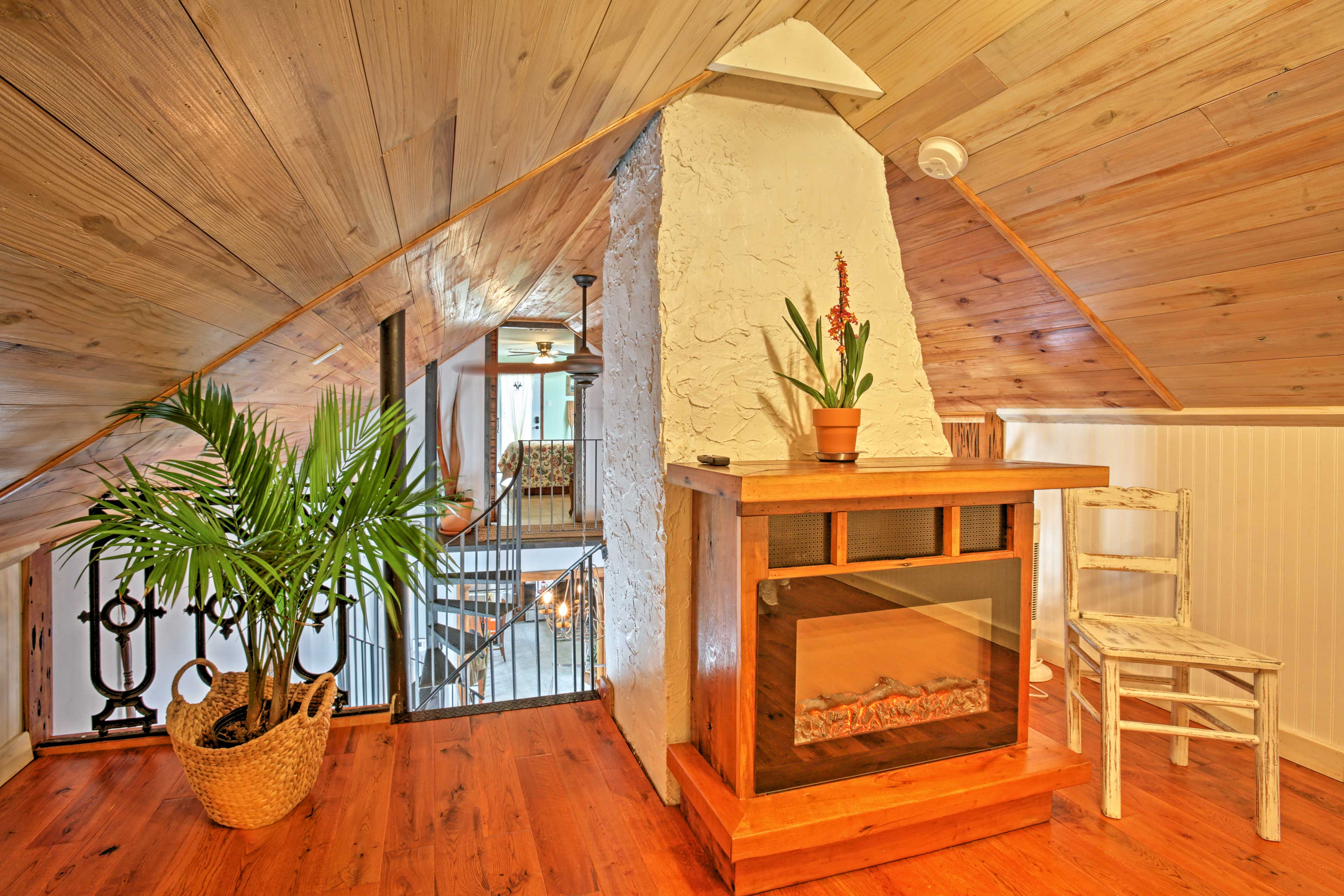 You'll love the warmth of the loft's electric fireplace.