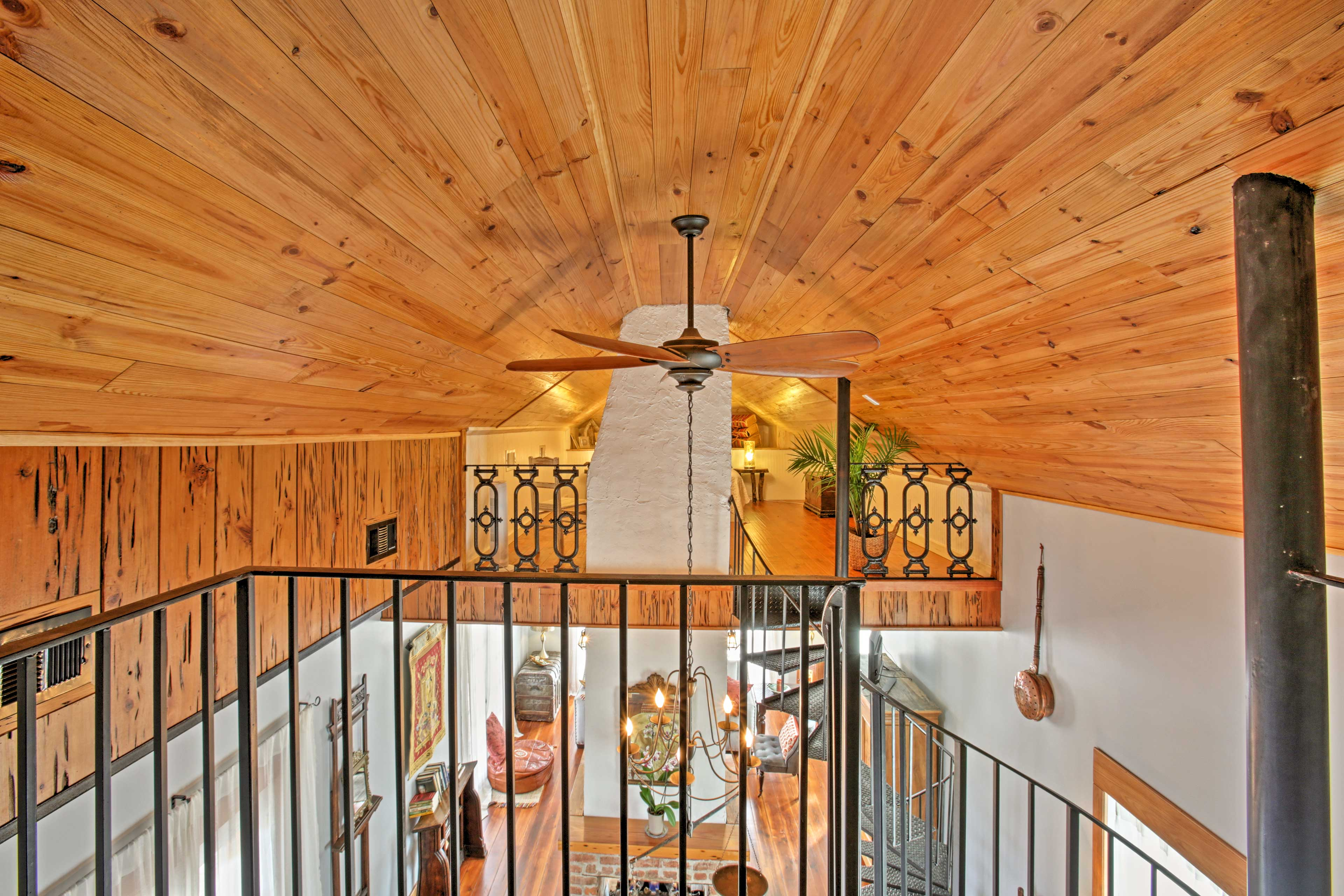 Both of the bedrooms balconies feature birds-eye views of the main living area.