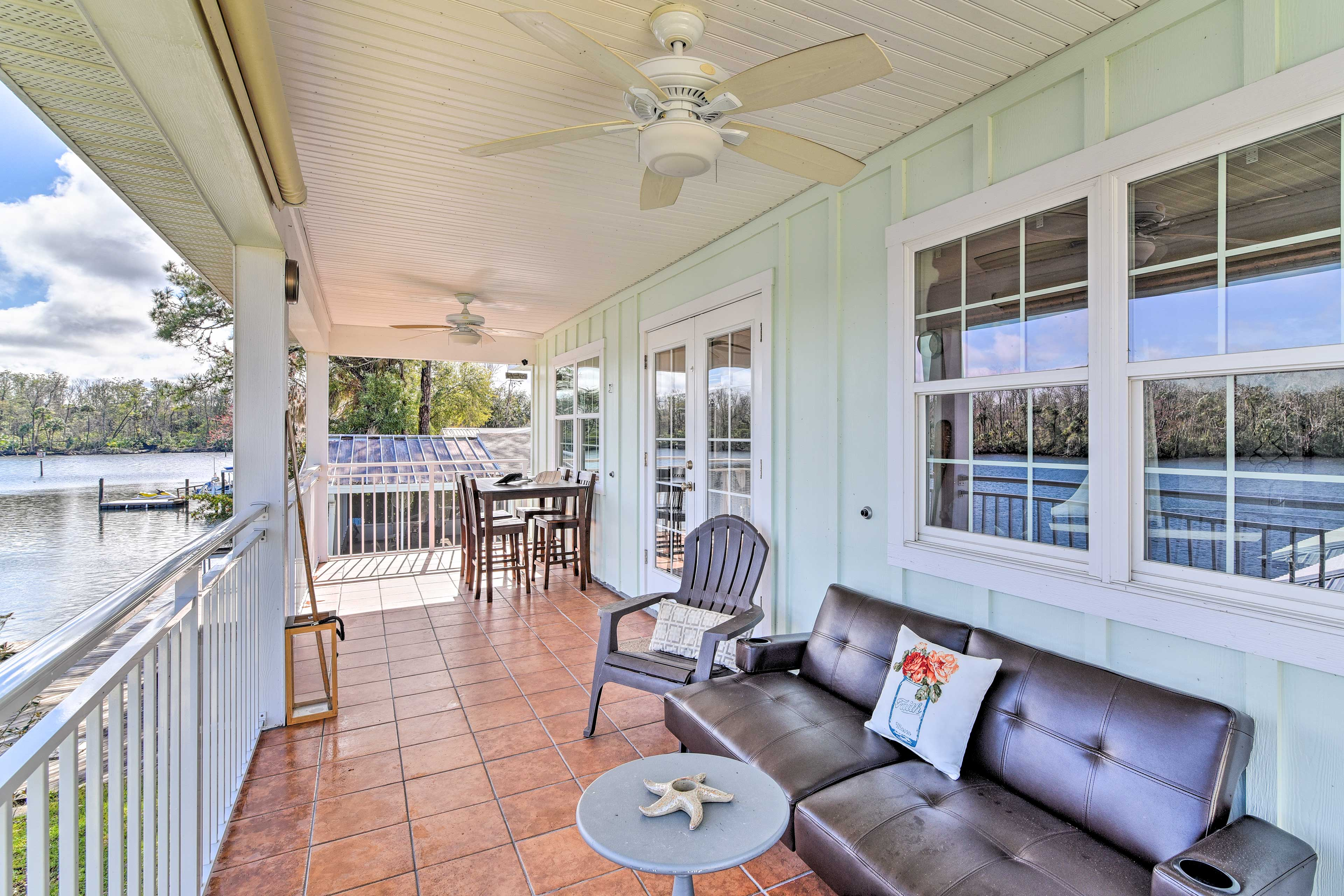 The covered porch has unparalleled views of the Homosassa River.