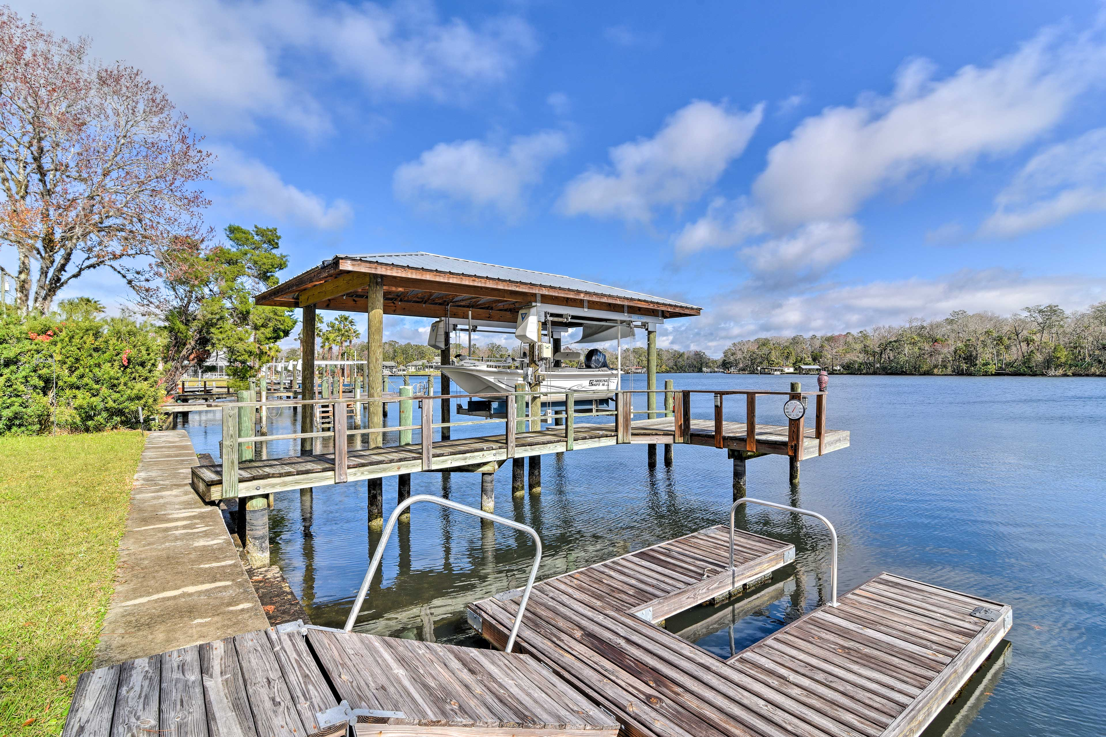 This home's large dock allows you to park your boat just steps away.