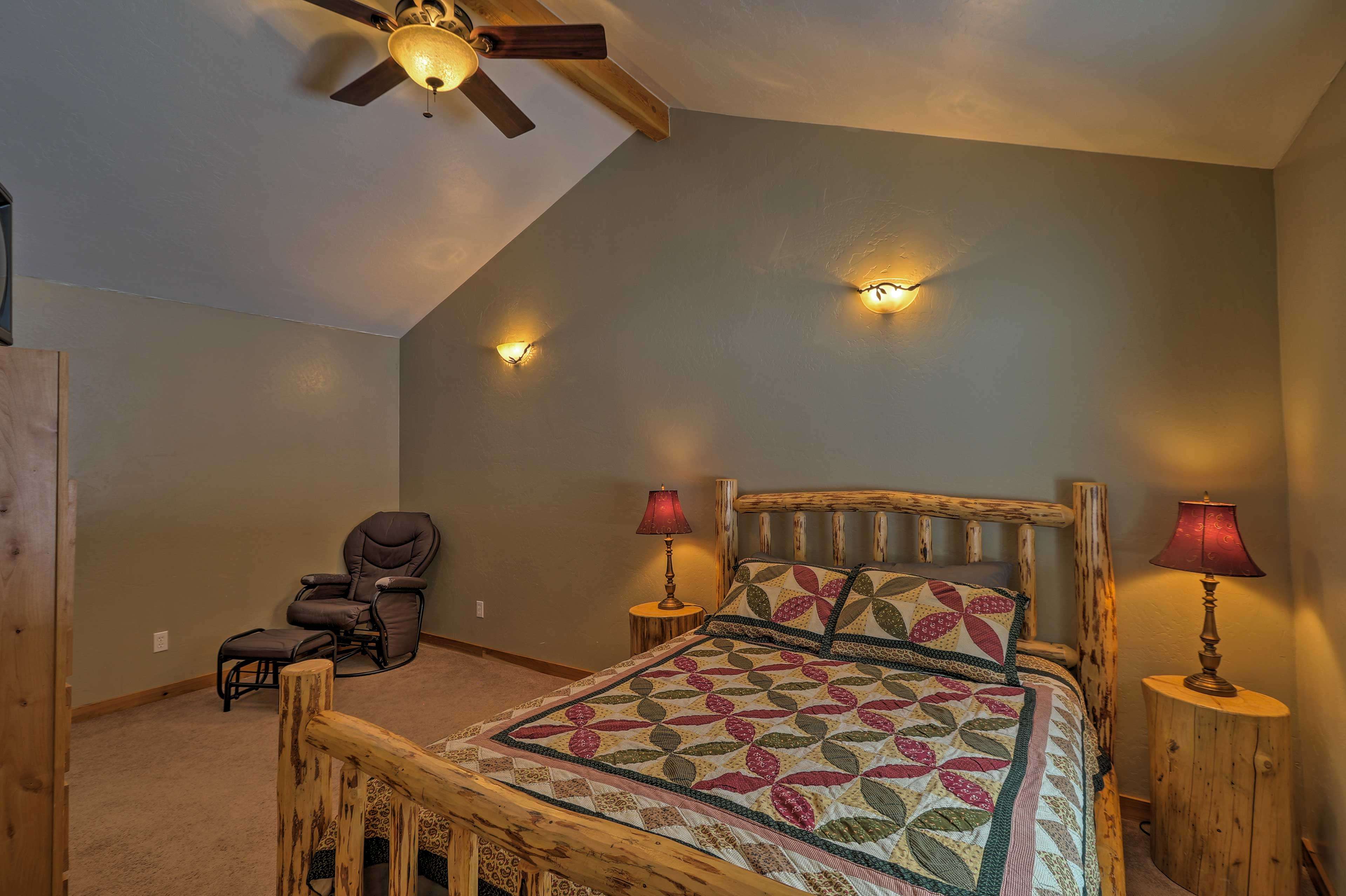 This first bedroom boasts a cozy queen bed.
