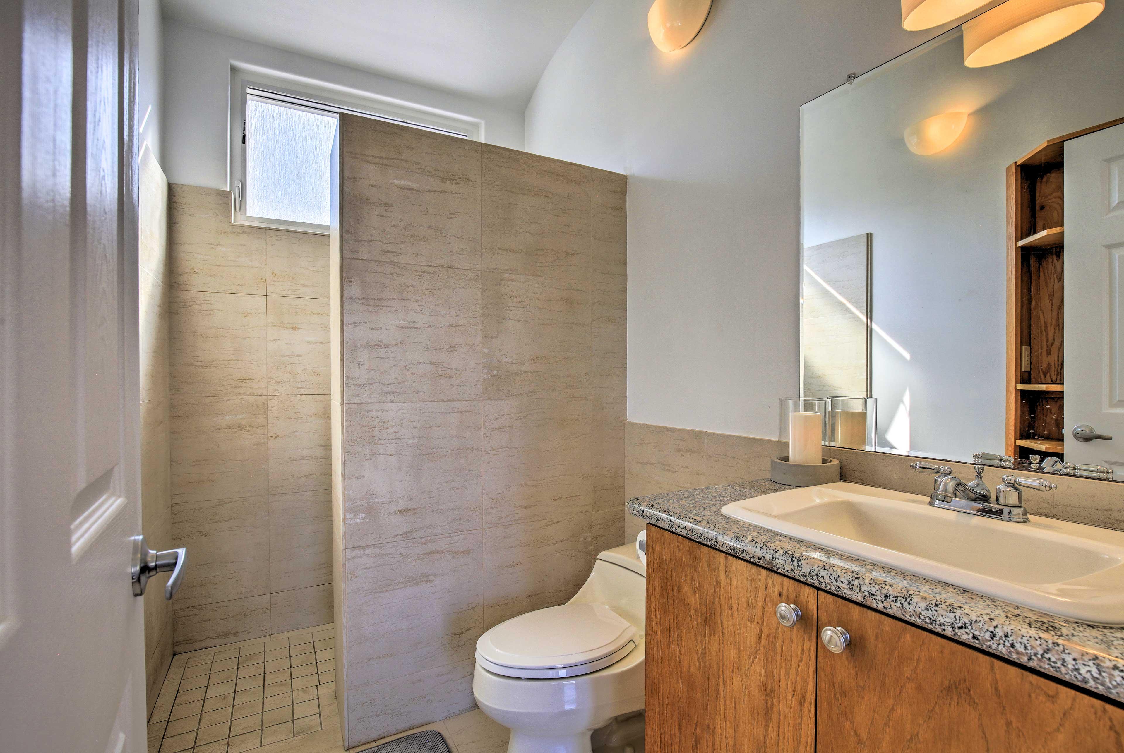 Wash up in the bathroom's single vanity before dinnertime.